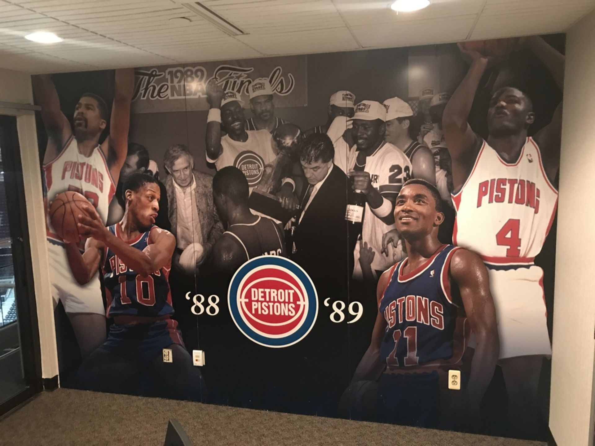 """Lot 1G - Wall Mural - """"88-89 Detroit Pistons"""" , Dim. 144 in x 94 in , Location: Suite ***Note from"""