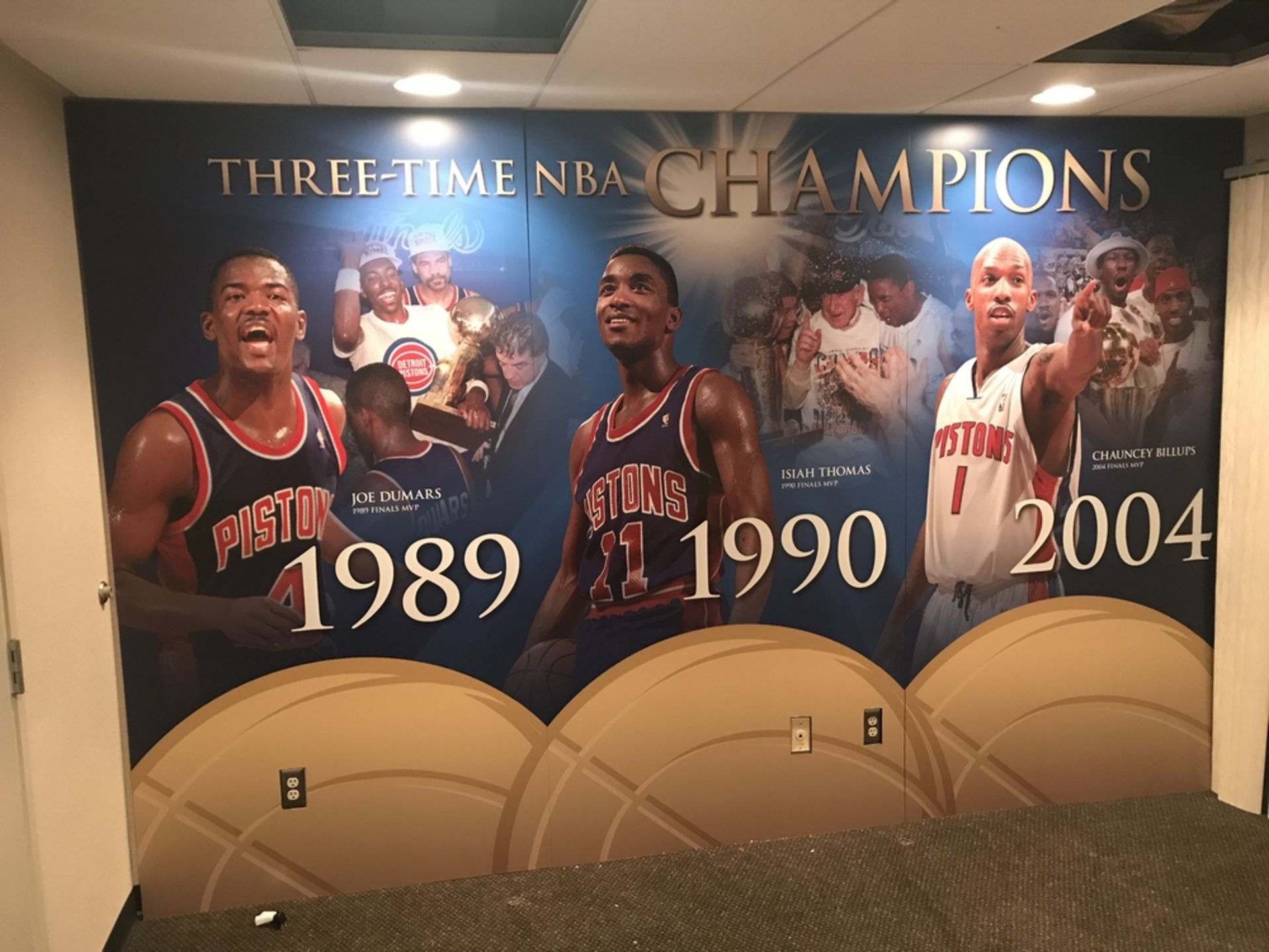 "Lot 1F - Wall Mural - ""Three Time NBA Champs"" 1989, 1990, 2004 (3 pc) , Dim. 144 in x 94 in , Location: Suite"