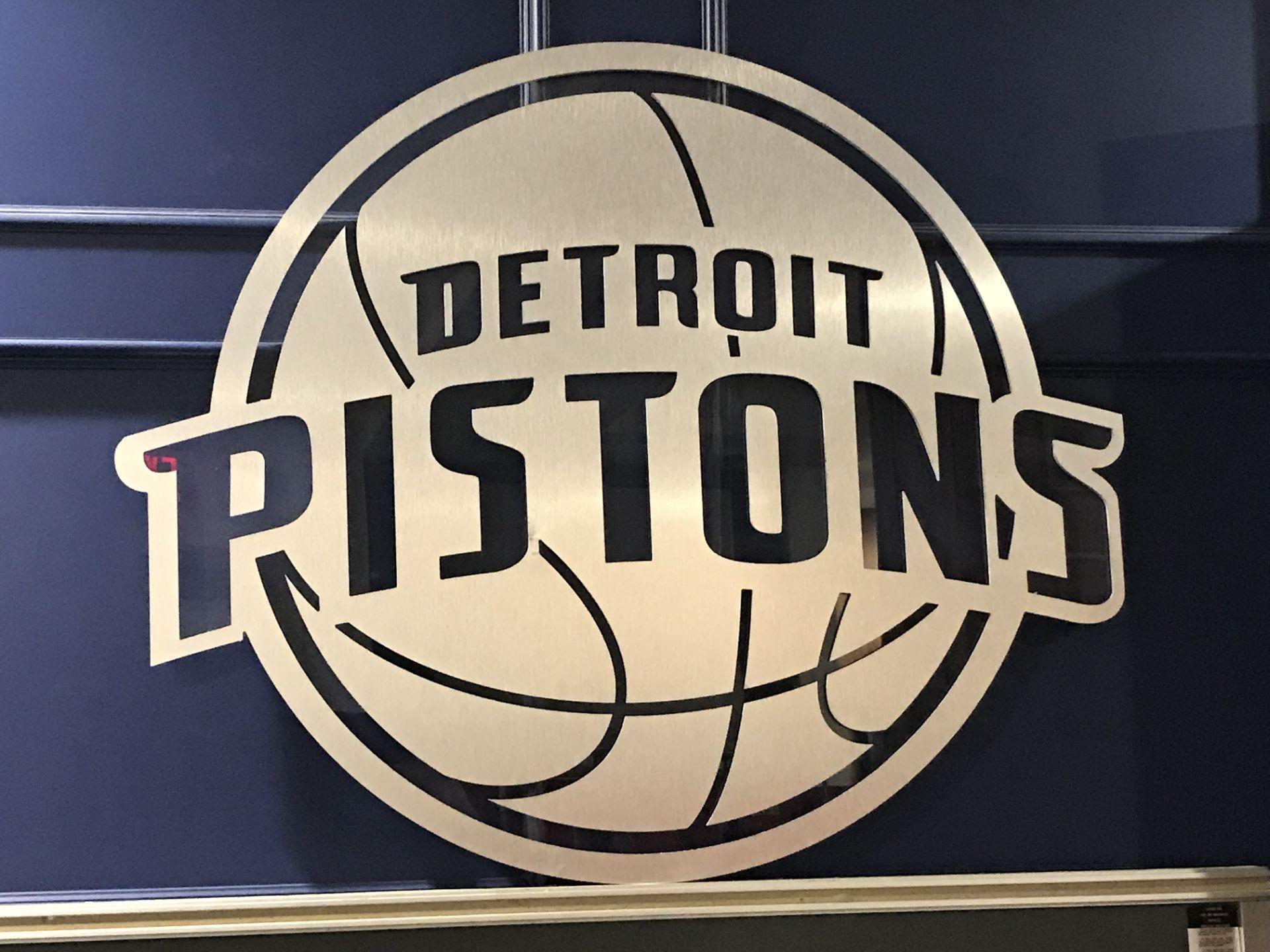 "Lot 1J - ""Detroit Pistons"" Emblem - Brushed Aluminum , Dim. 38 in x 32 in , Location: Press Box ***Note"
