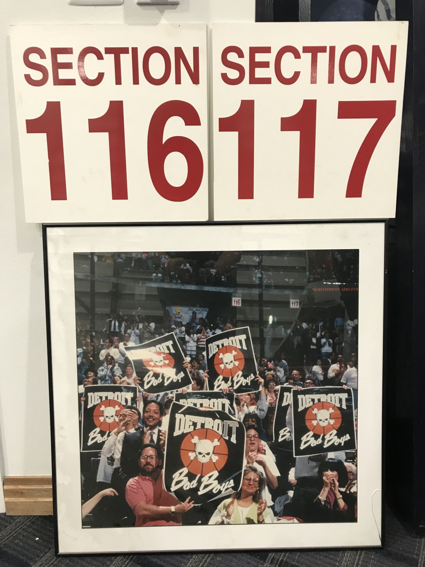 Lot 1I - Lot of: Framed Picture of Fans with Sec 116 & 117 in Background Along With Signs in the Picture ,