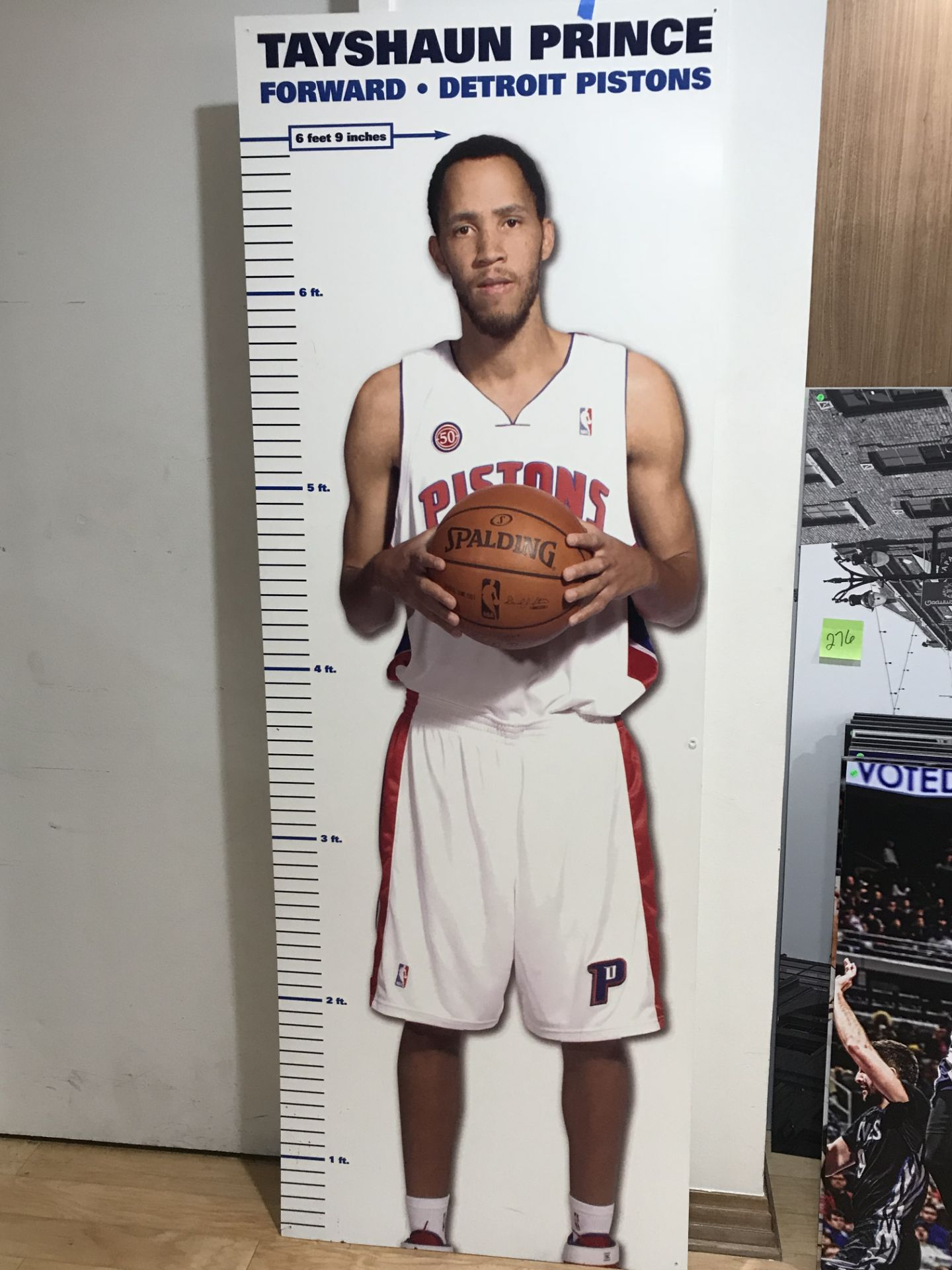 """Lot 18K - """"Tayshaun Prince"""" Height Chart, Thick Plastic , Dim. 29 in x 82 in , Location: Suite ***Note from"""
