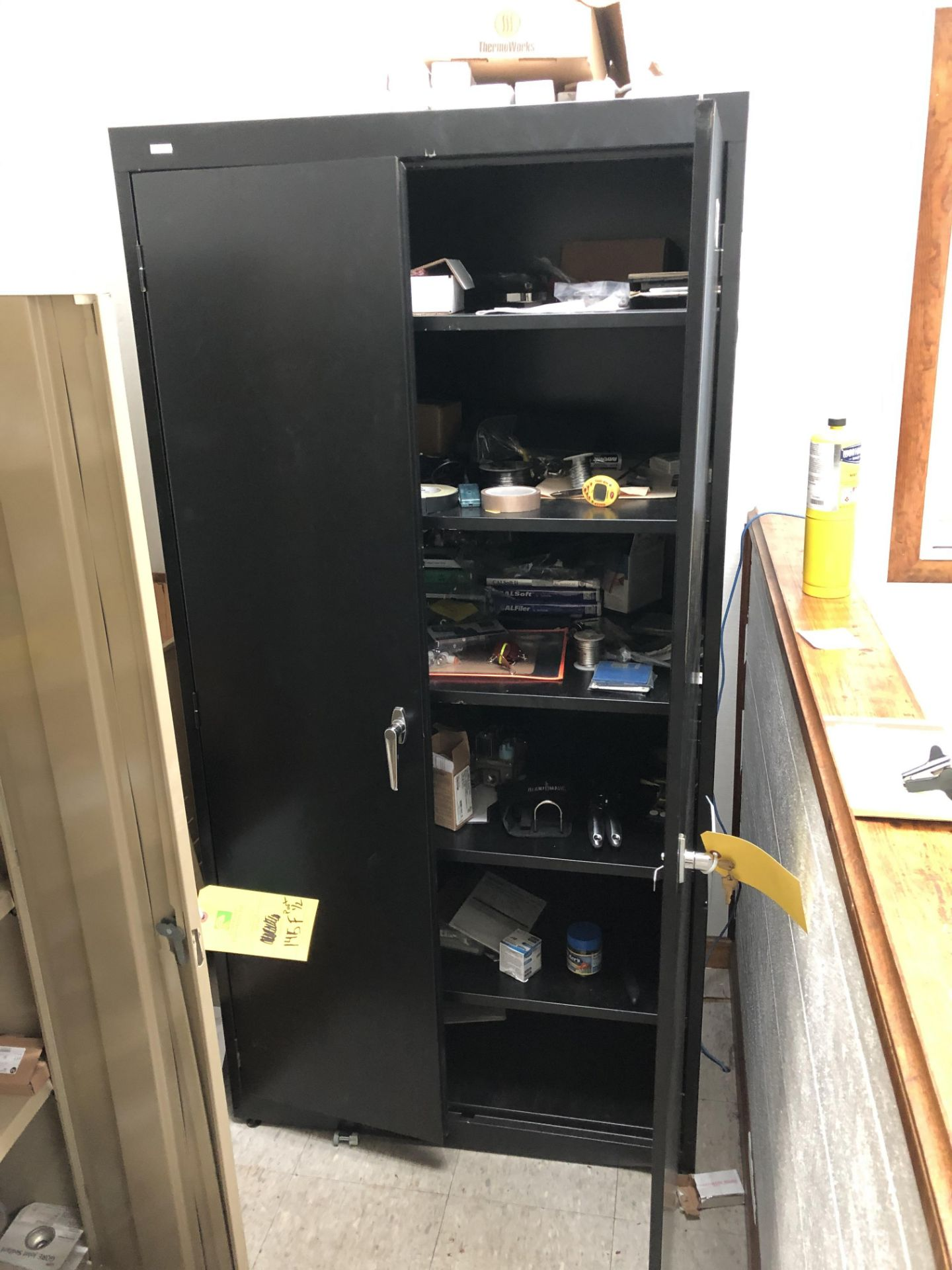 Lot 145F - (1) Black Storage Cabinet & (1) Tan Storage Cabinet W/ All Contents