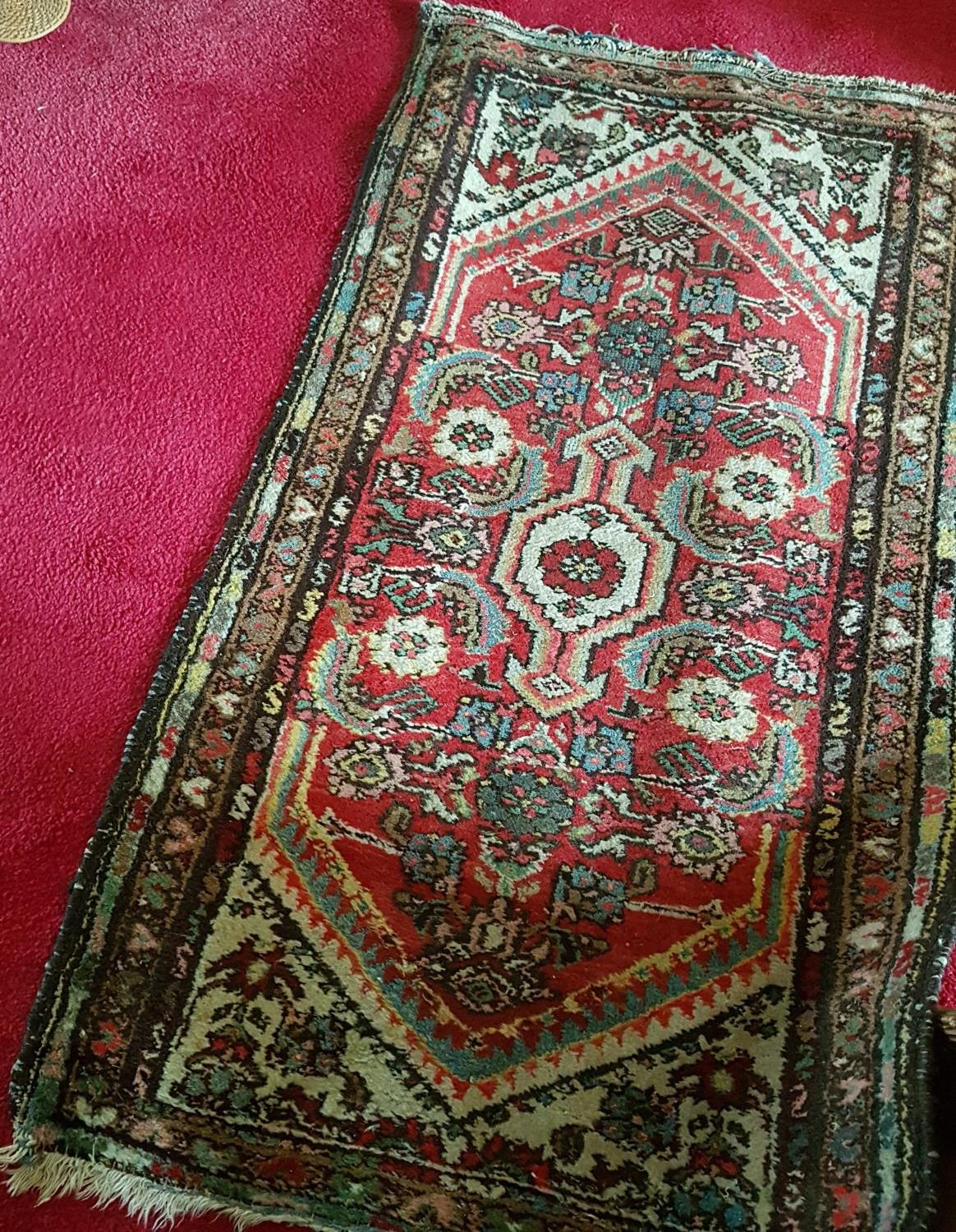 Lot 49A - A small Eastern Rug.