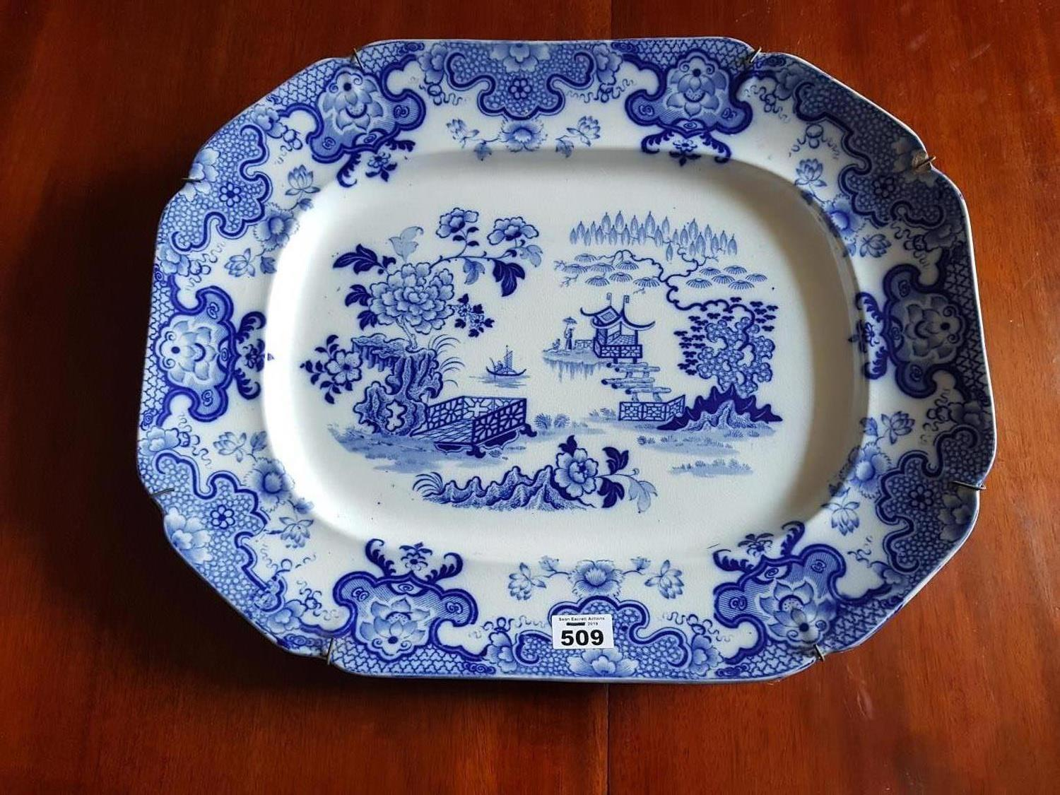 Lot 509 - A 19th Century Blue and White Meat Charger in an Oriental design. 50 cms x 40 cms.