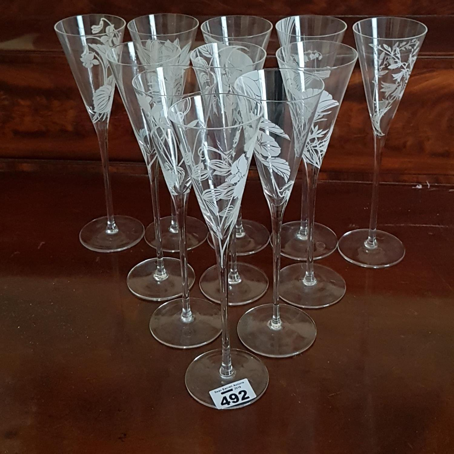 Lot 492 - A lovely set of Australian etched Champagne Flutes.