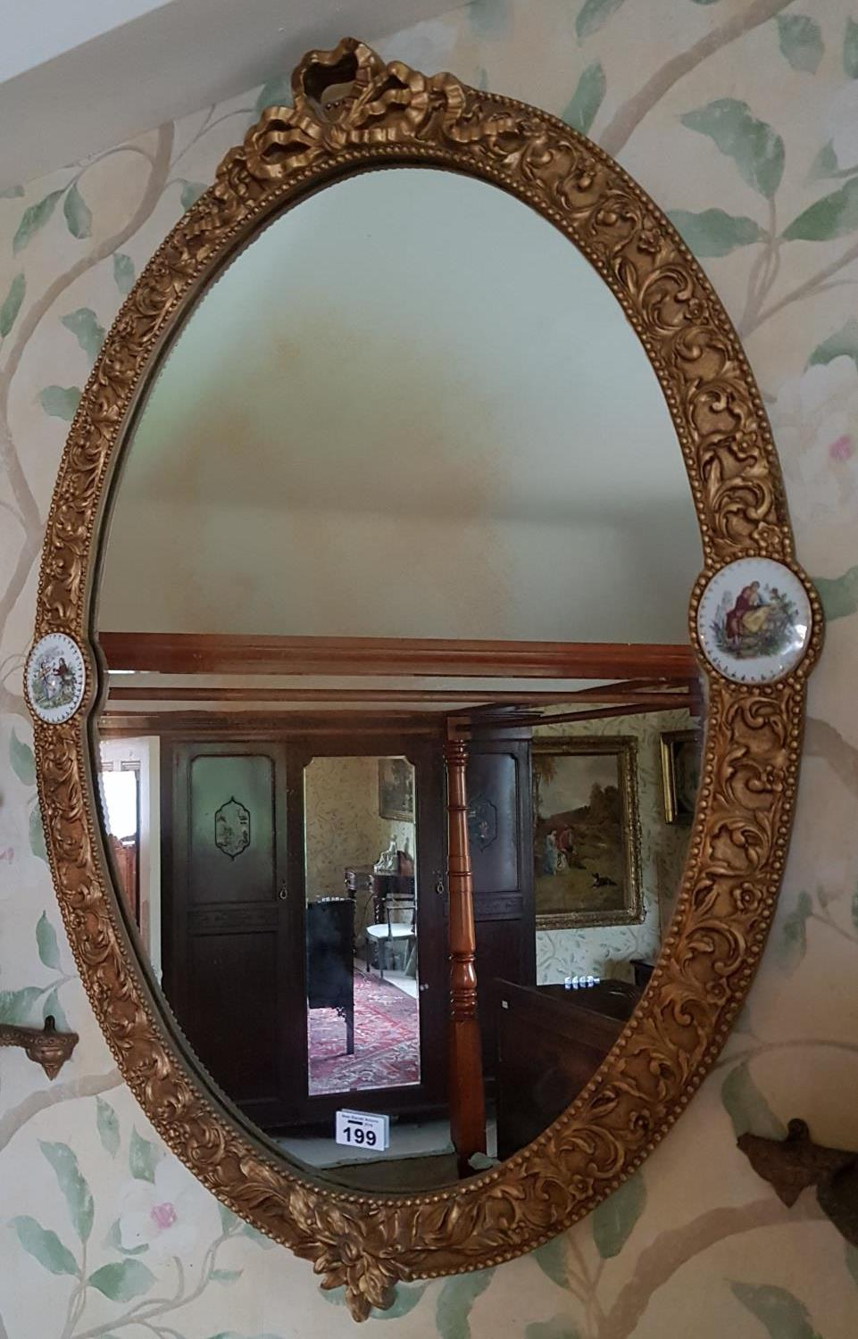 Lot 199 - A late 19th early 20th Century Oval Gilt Mirror with Sevre style plaques.
