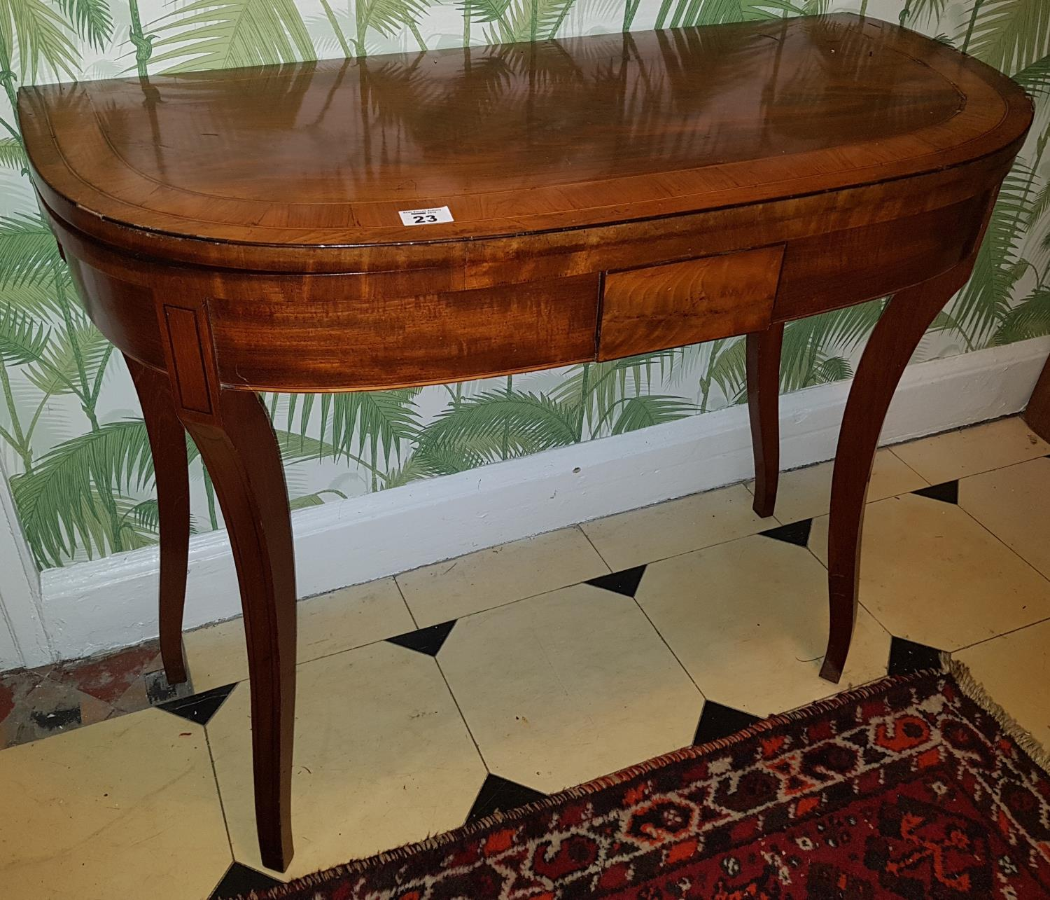 Lot 23 - A Regency Mahogany Crossbanded Foldover Card Table with carved tapered supports. 92cm.