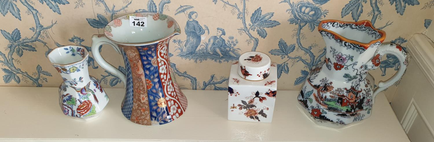 Lot 142 - Two Masons Ironstone Jugs along with another jug and vase.