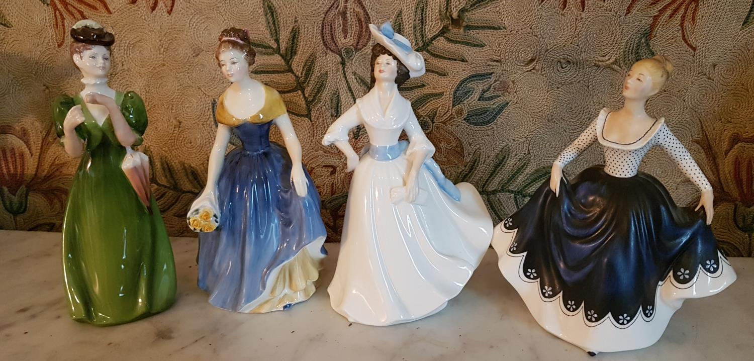 Lot 268 - A set of three Royal Doulton Figures and another. Melanie HN2271, Lisa HN2310 and Margaret HN2397.