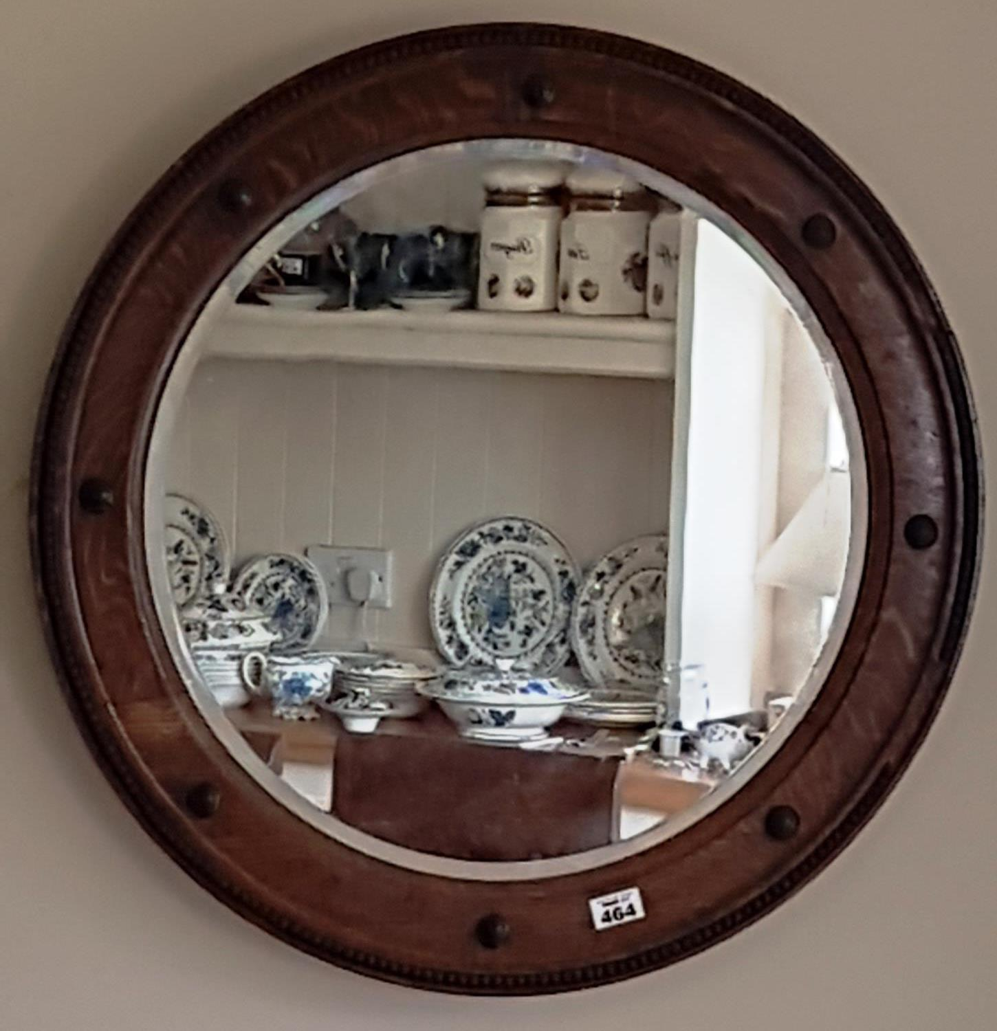 Lot 464 - A lovely Circular Oak Mirror by Denby & Spinks of Leeds. 64 cms diam.