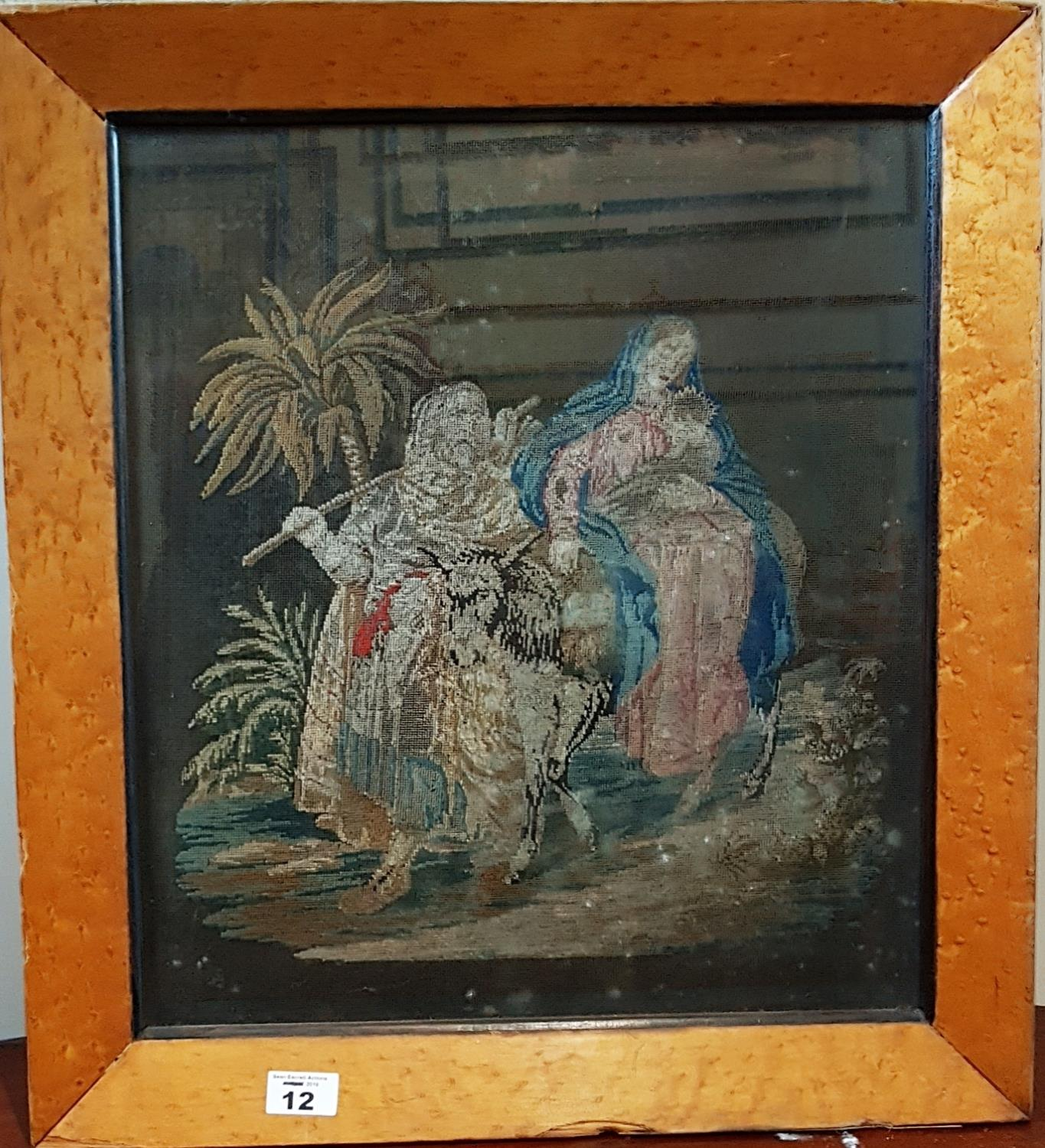 Lot 12 - A 19th Century Tapestry in a birds eye maple frame. 39cm.