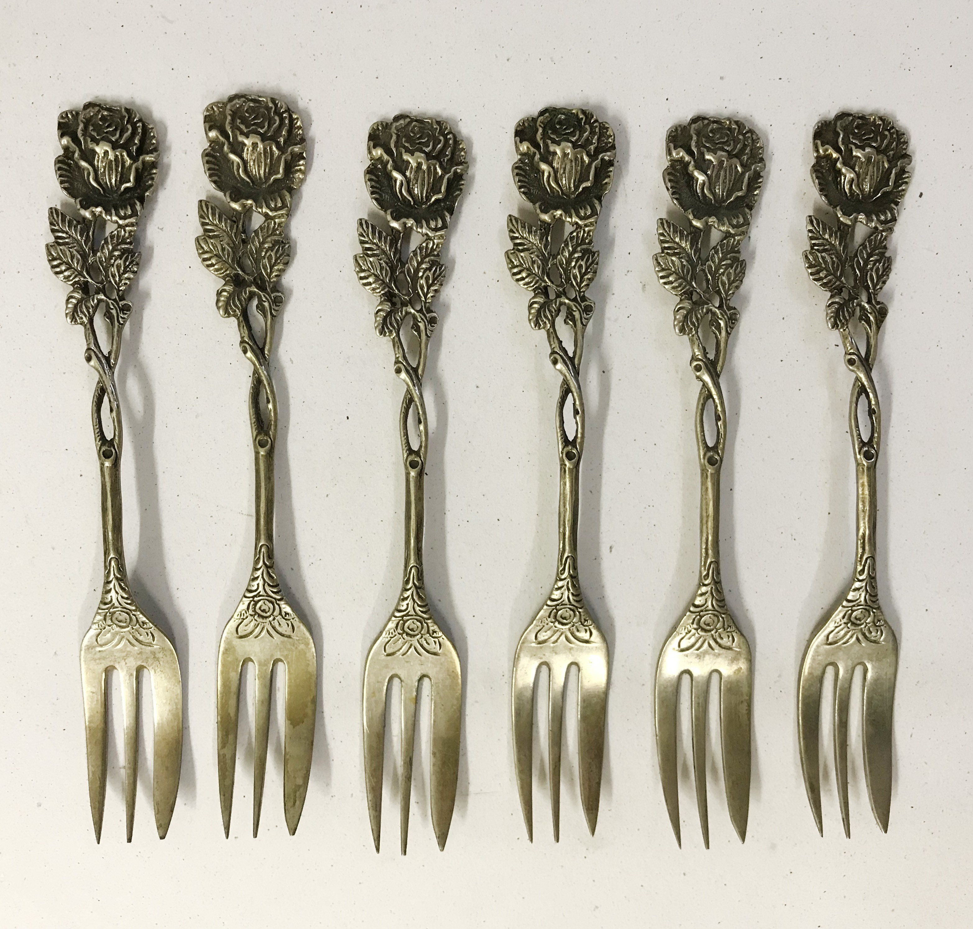 Lot 10 - ANTIQUE SET OF SIX GERMAN DESERT FORKS WITH FLORAL PATTERN HALLMARKED 835
