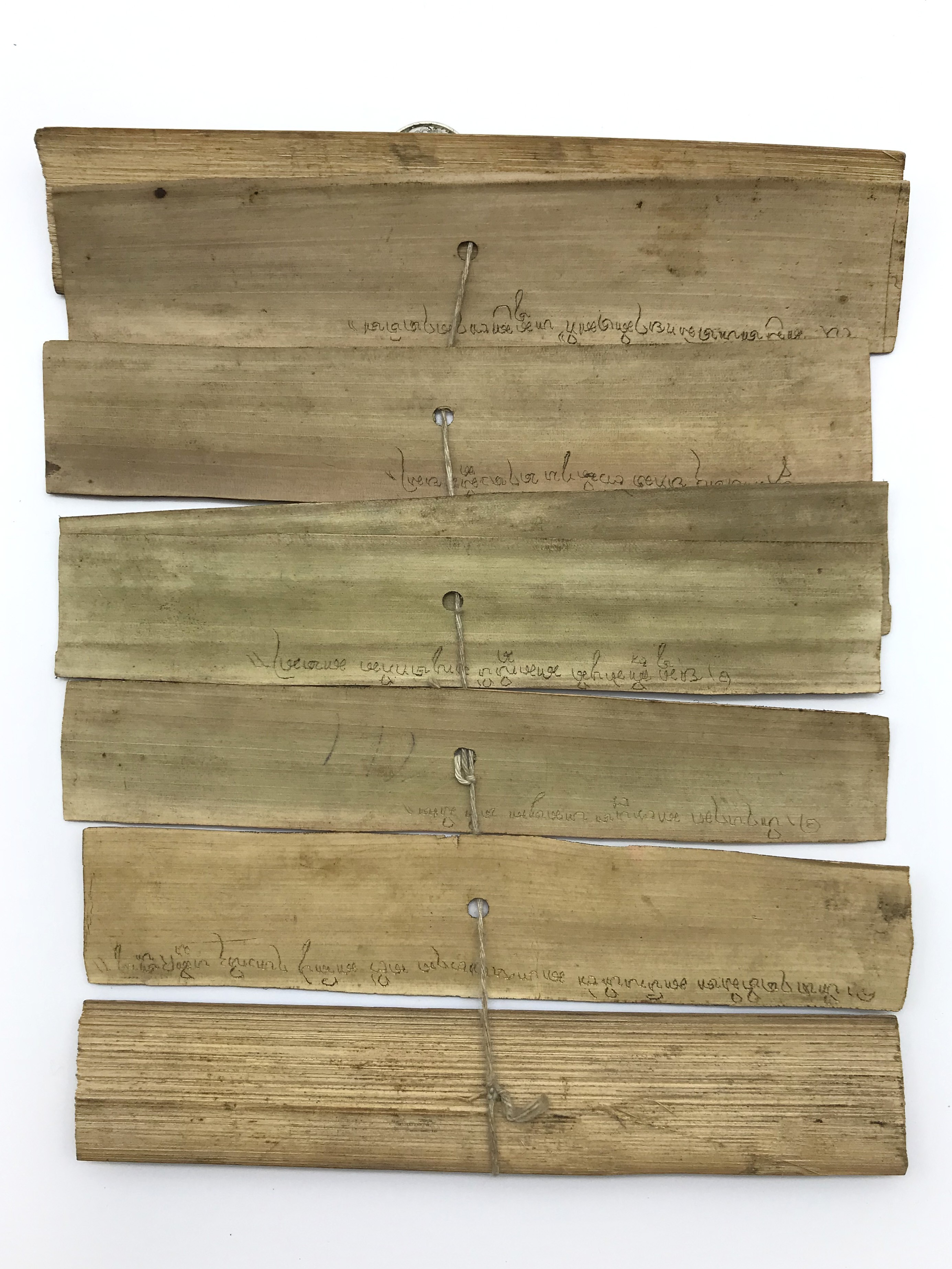 Lot 31 - TIBETAN CHINESE RELIGIOUS PICTURES ON BAMBOO LEAVES