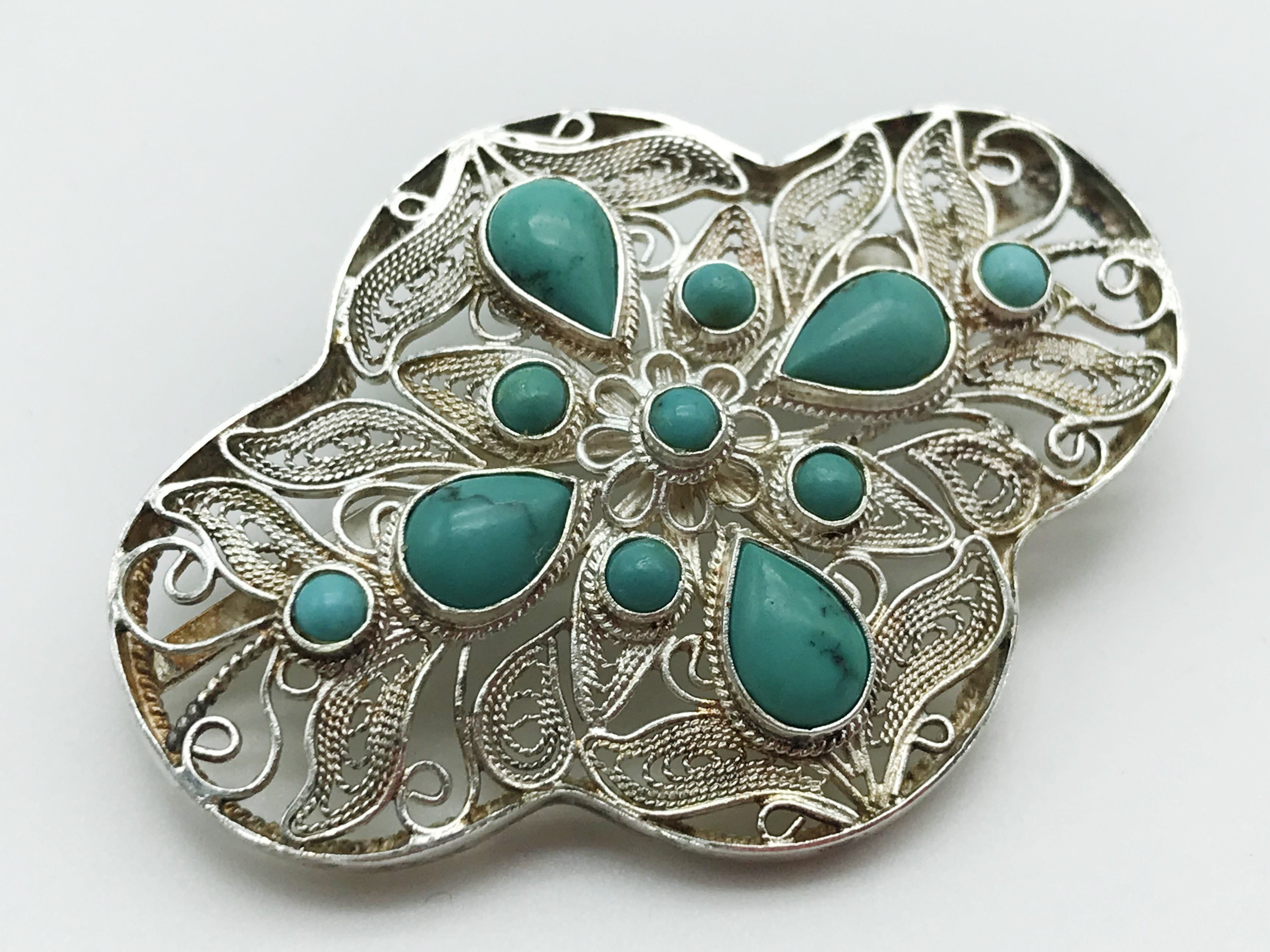 Lot 28 - TWO WHITE METAL / SILVER ISLAMIC BROOCHES