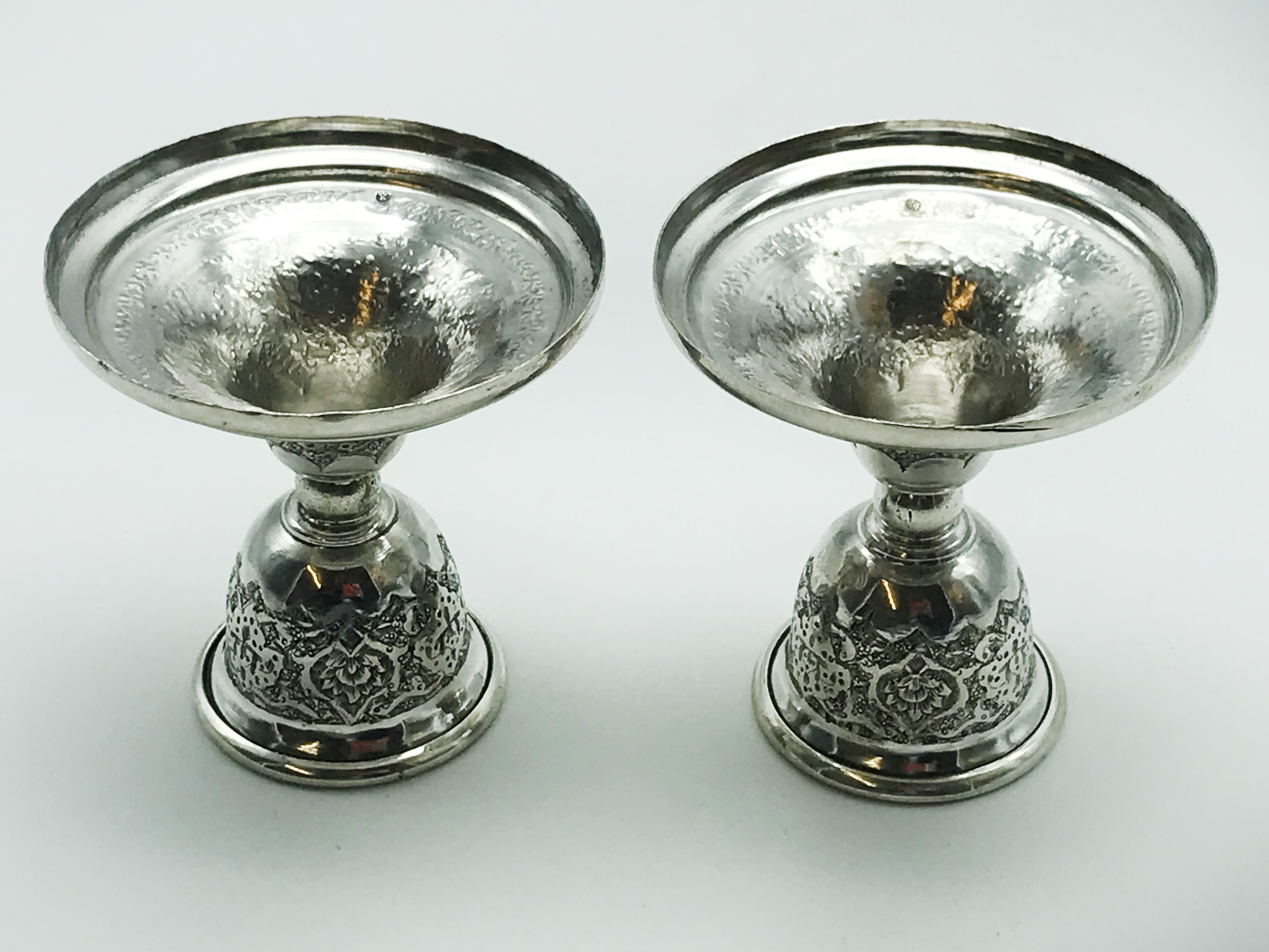 Lot 10 - PAIR OF SMALL RUSSIAN OR MIDDLE EASTERN SILVER CANDLESTICKS HALLMARKED 84