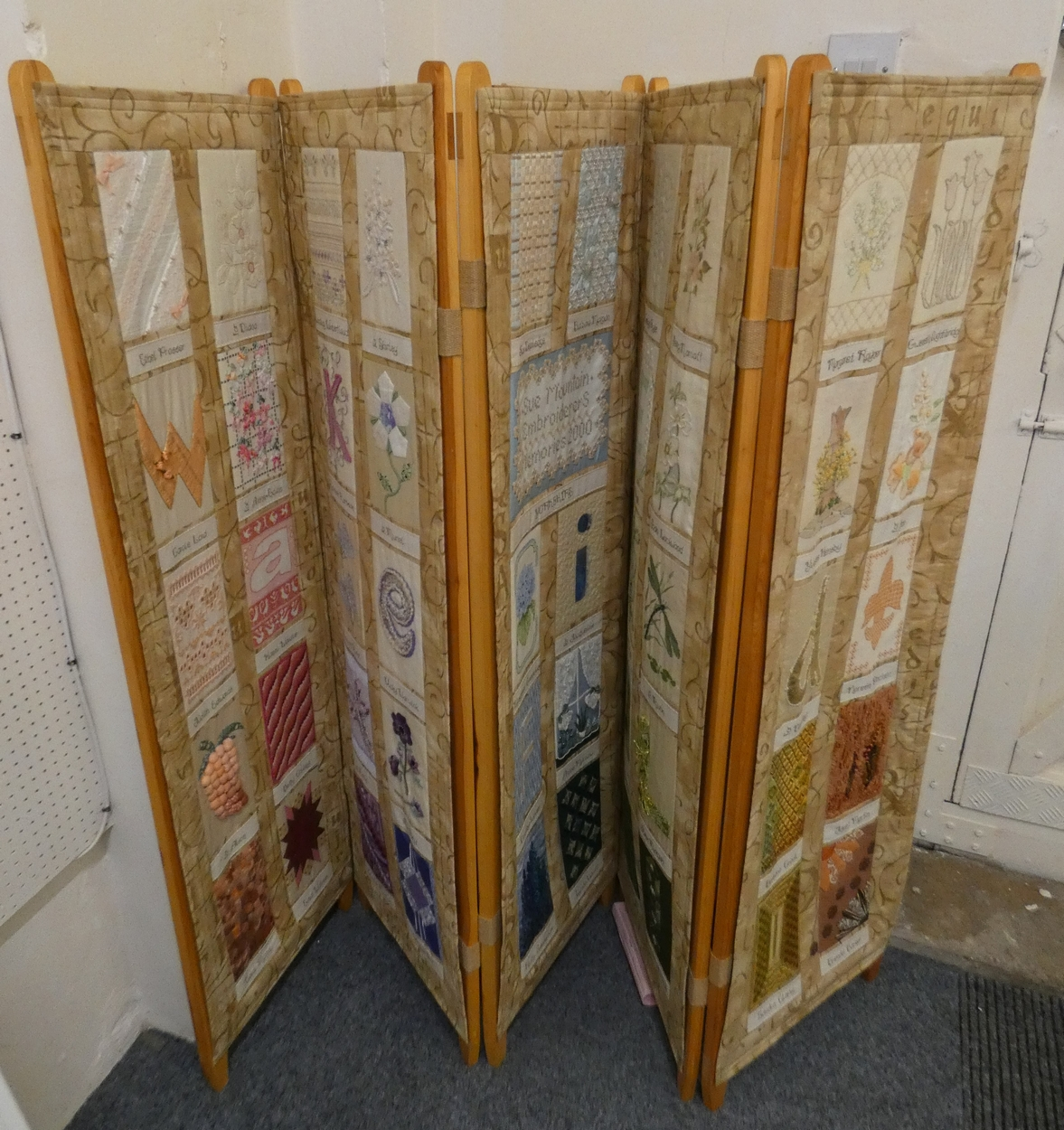 Lot 174 - A five fold pine dressing screen with each fold comprising ten individual embroideries, the screen