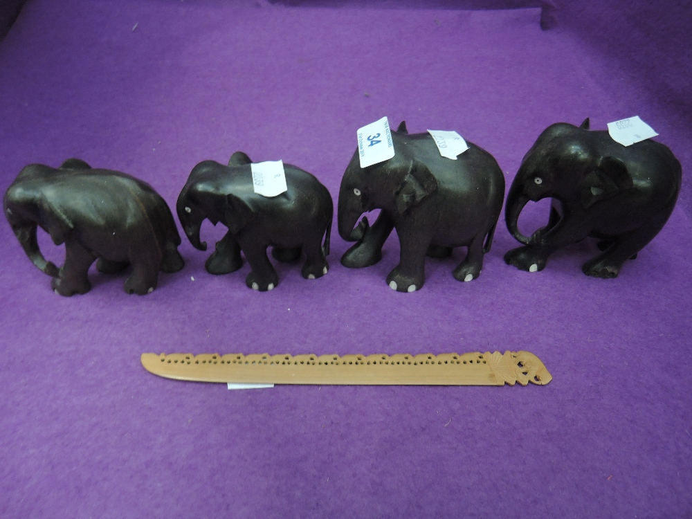 Lot 34 - A selection of ethnic wood hand carved elephants including page turner