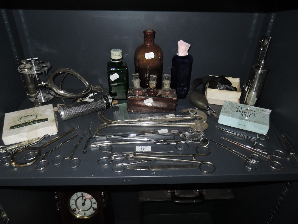 Lot 19 - A selection of medical and surgical instruments including bottle set