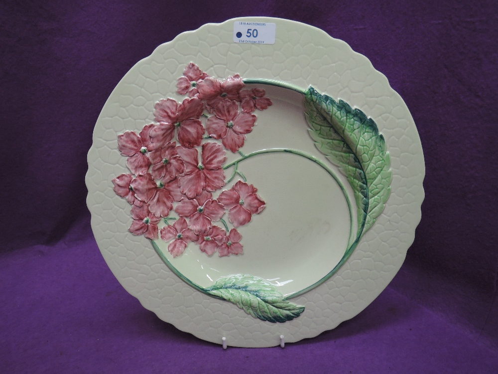 Lot 50 - A Carltonware platter of floral design on typical light green ground