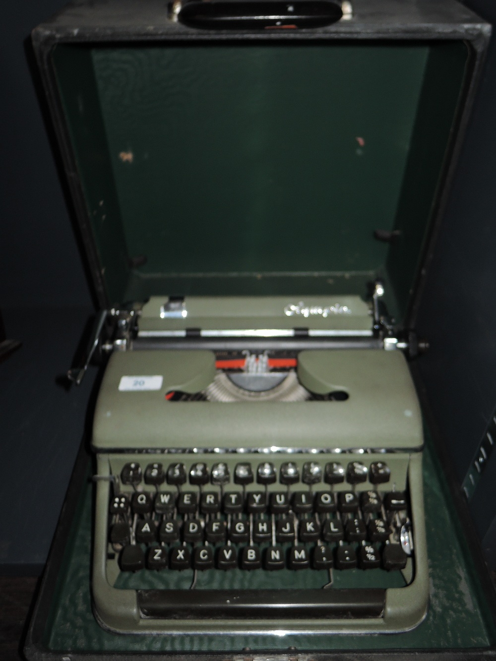 Lot 20 - A vintage typewriter by Olympia in olive green