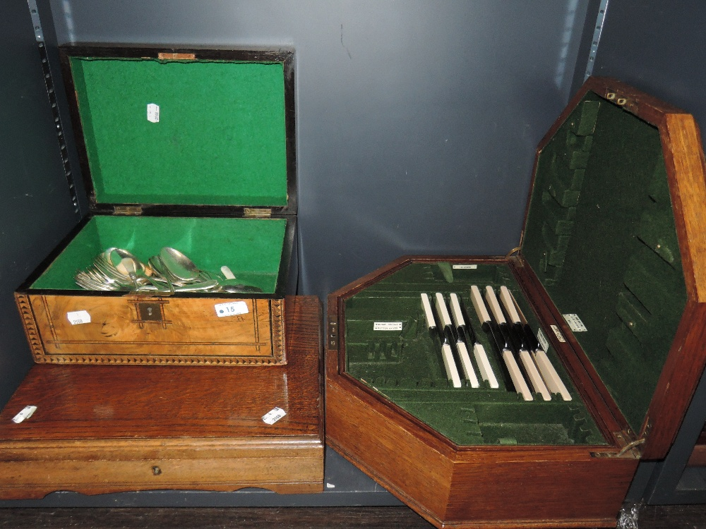 Lot 15 - Two canteens containing part sets of silver plated cutlery and a treen box containing loose plated