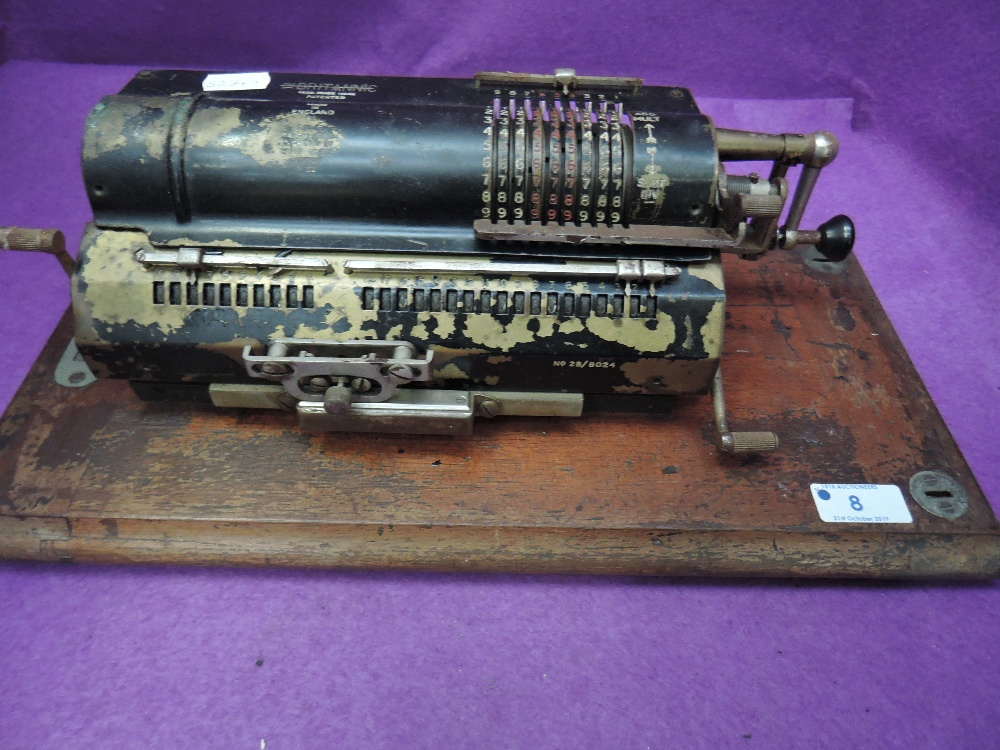 Lot 8 - A vintage Britannic patent calculator machine, London N22 (no lid)