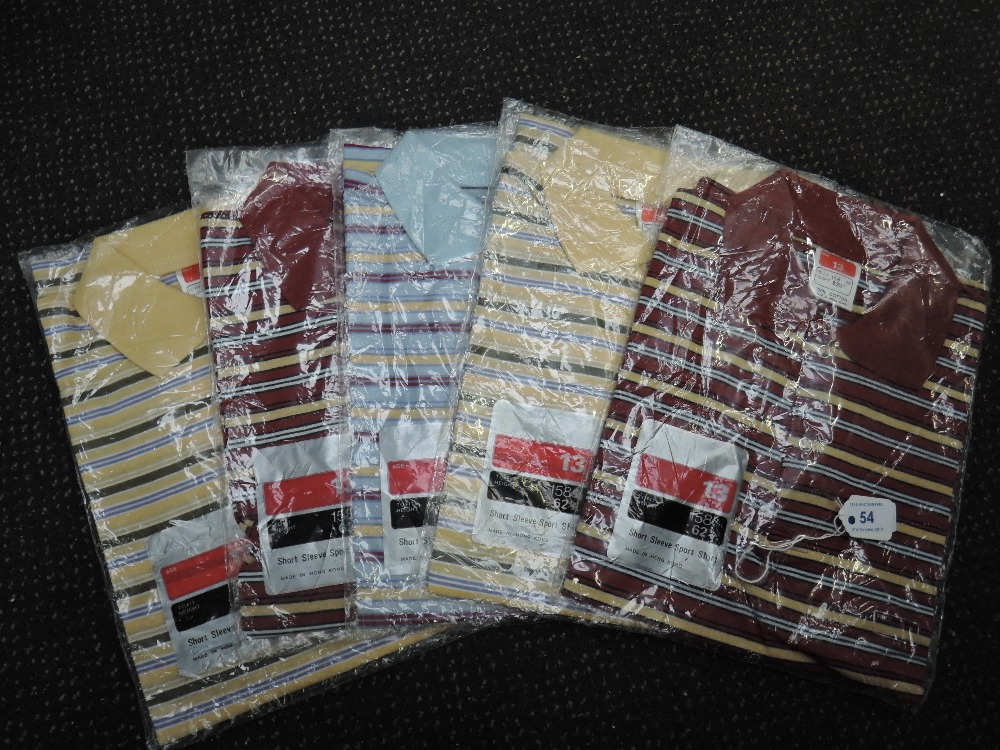 Lot 54 - Five vintage 1970s boys striped polo tops, age 13. In unworn condition.