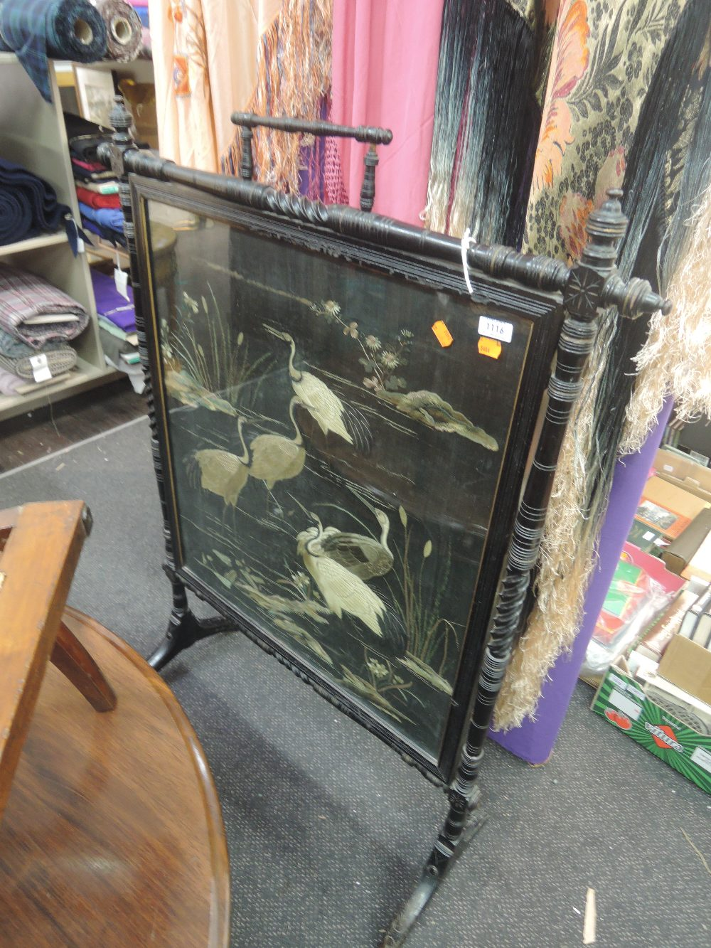 Lot 1116 - A Victorian ebonized frame fire screen in the aesthectic style having reeded and twist frame with an