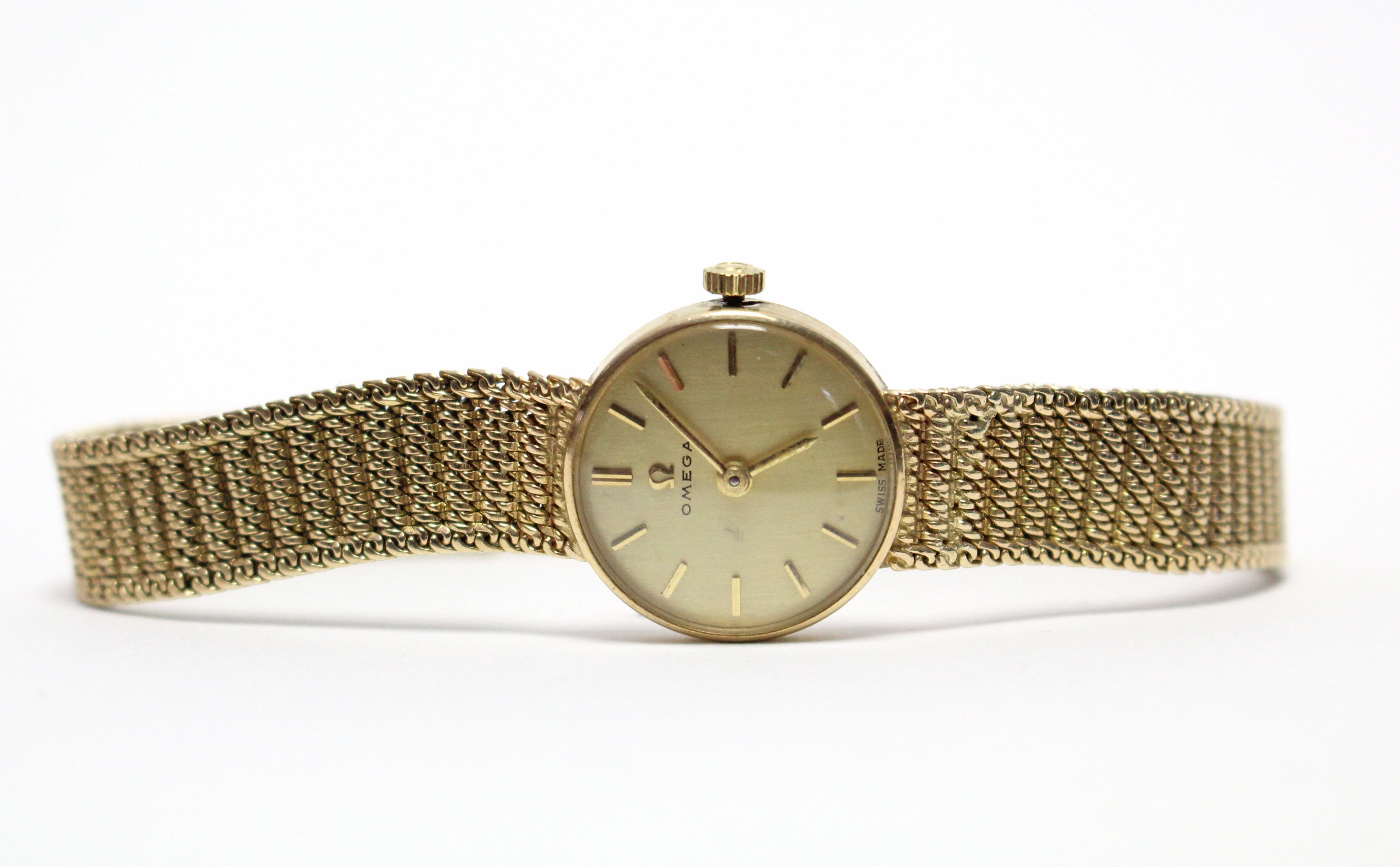 Lot 29 - A 1960's Omega ladies' wristwatch, the circular champagne dial with gold baton numerals & hands,