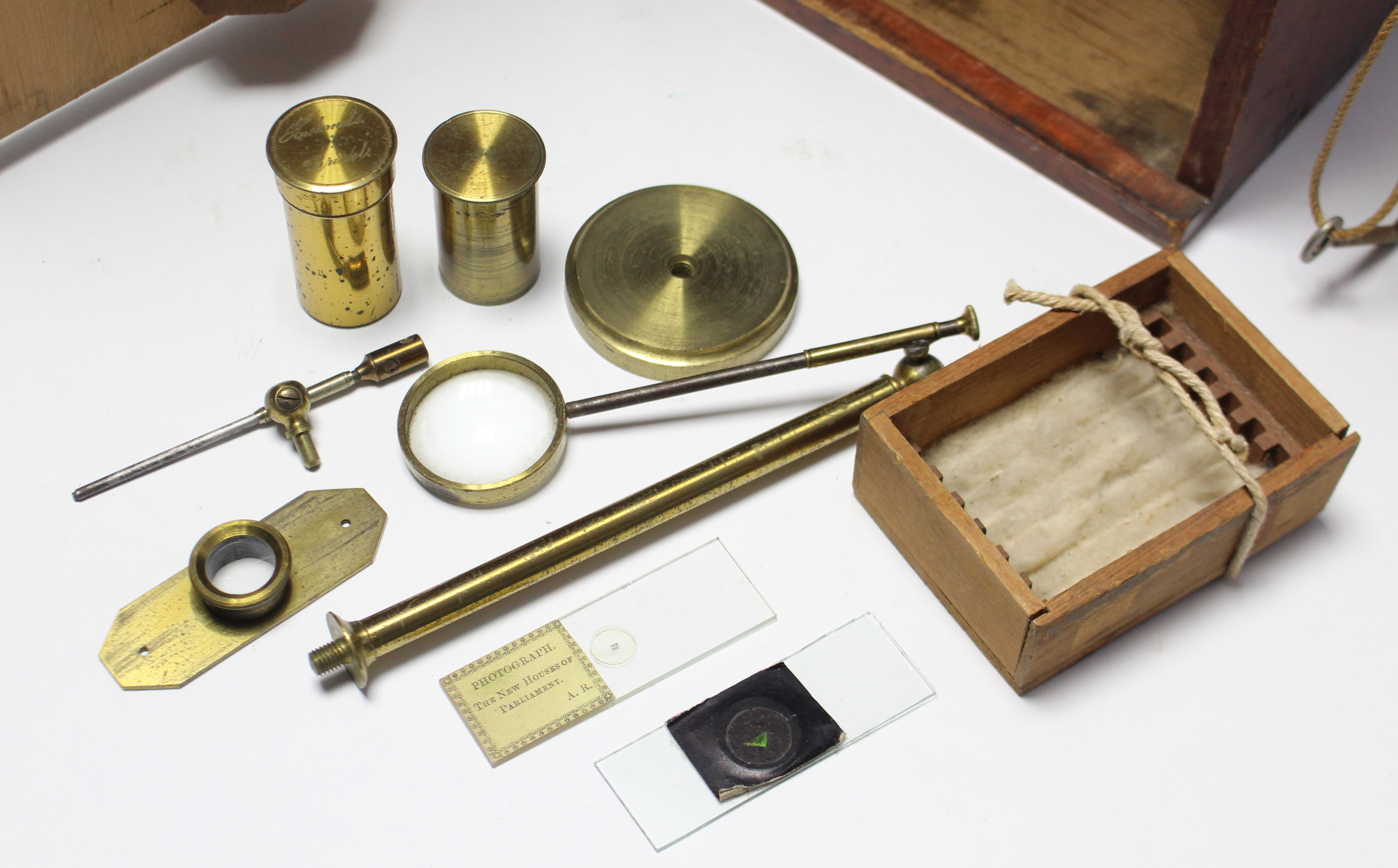 Lot 56 - AN EARLY 20th century BRASS MONOCULAR TELESCOPE by HUSBANDS & CLARKE of BRISTOL; together with