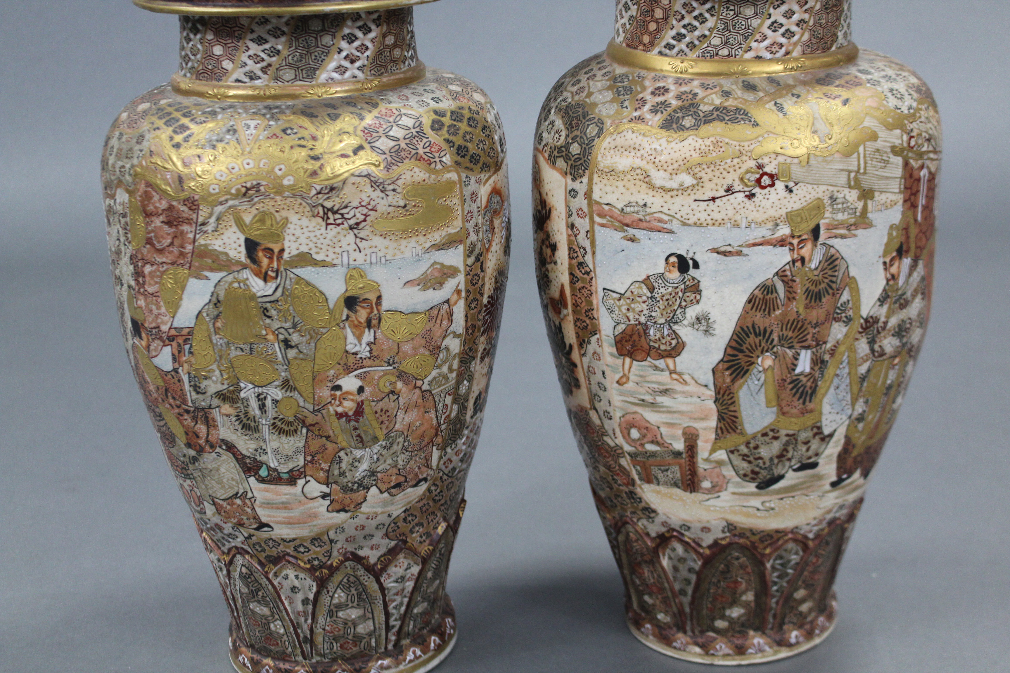 Lot 388 - A pair of late 19th century Japanese Satsuma pottery large ovoid vases with figure decoration &