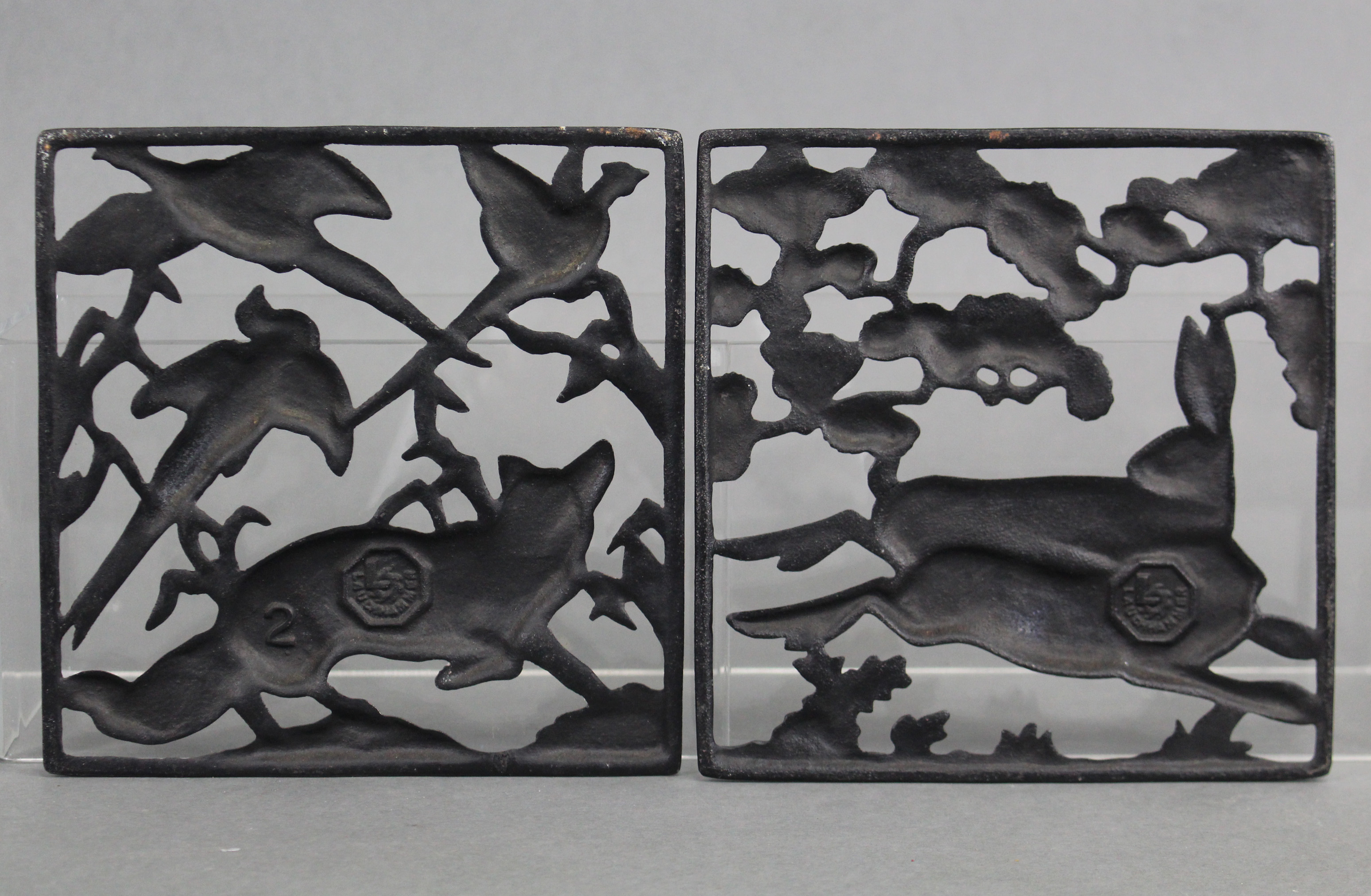 Lot 199 - A pair of Lauchhammer Art Deco cast & pierced iron square panels depicting running hares, a fox, &