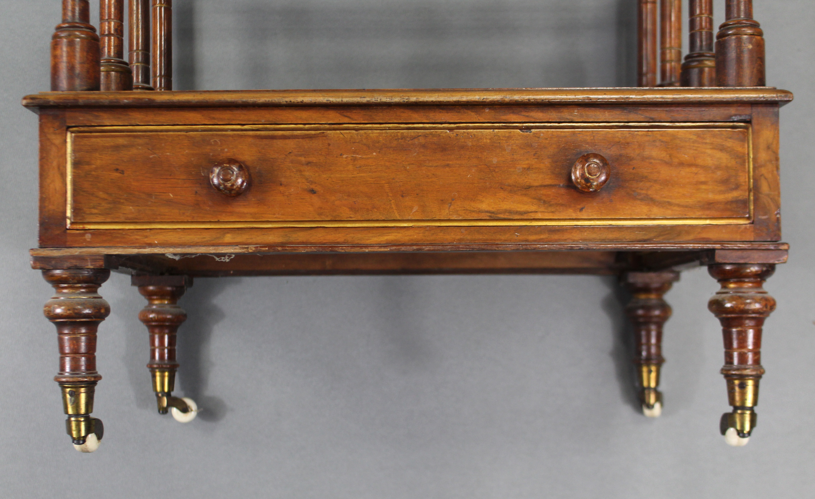 Lot 328 - An early Victorian mahogany & parcel-gilt three-division canterbury with turned uprights & dividers,