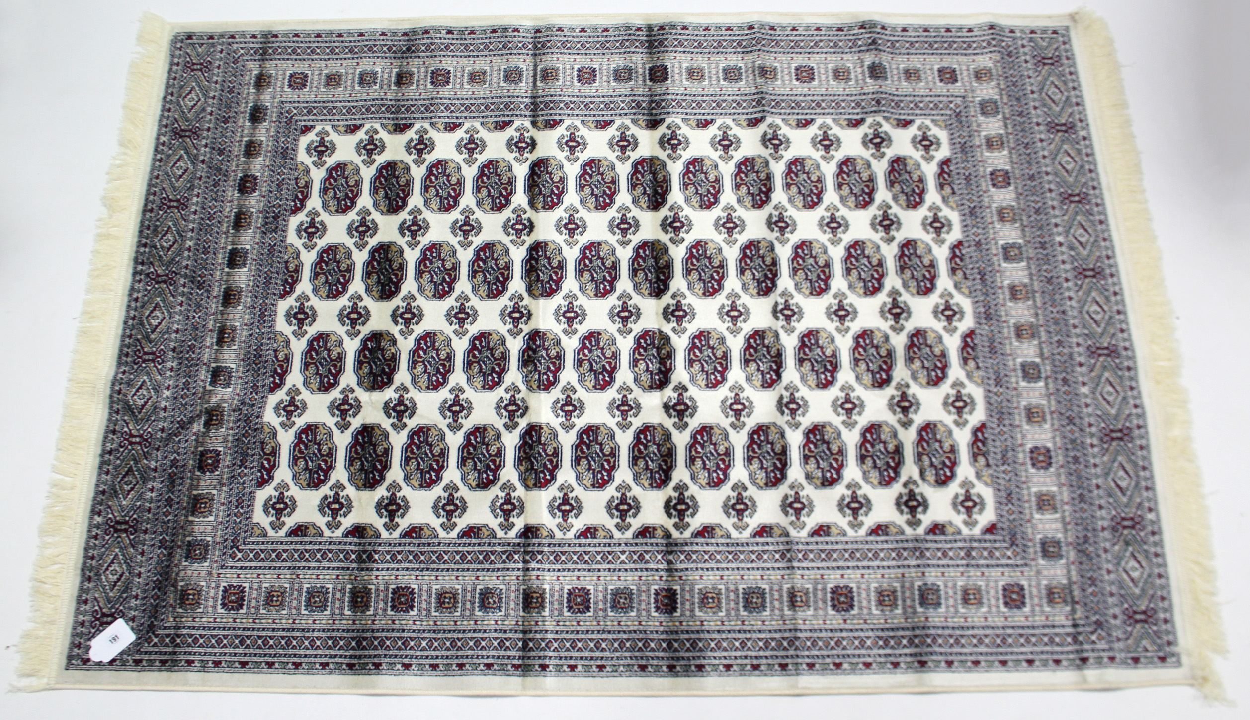 Lot 168 - A Bokhara rug of beige & crimson ground & with four rows of twelve guhls to centre within a multiple