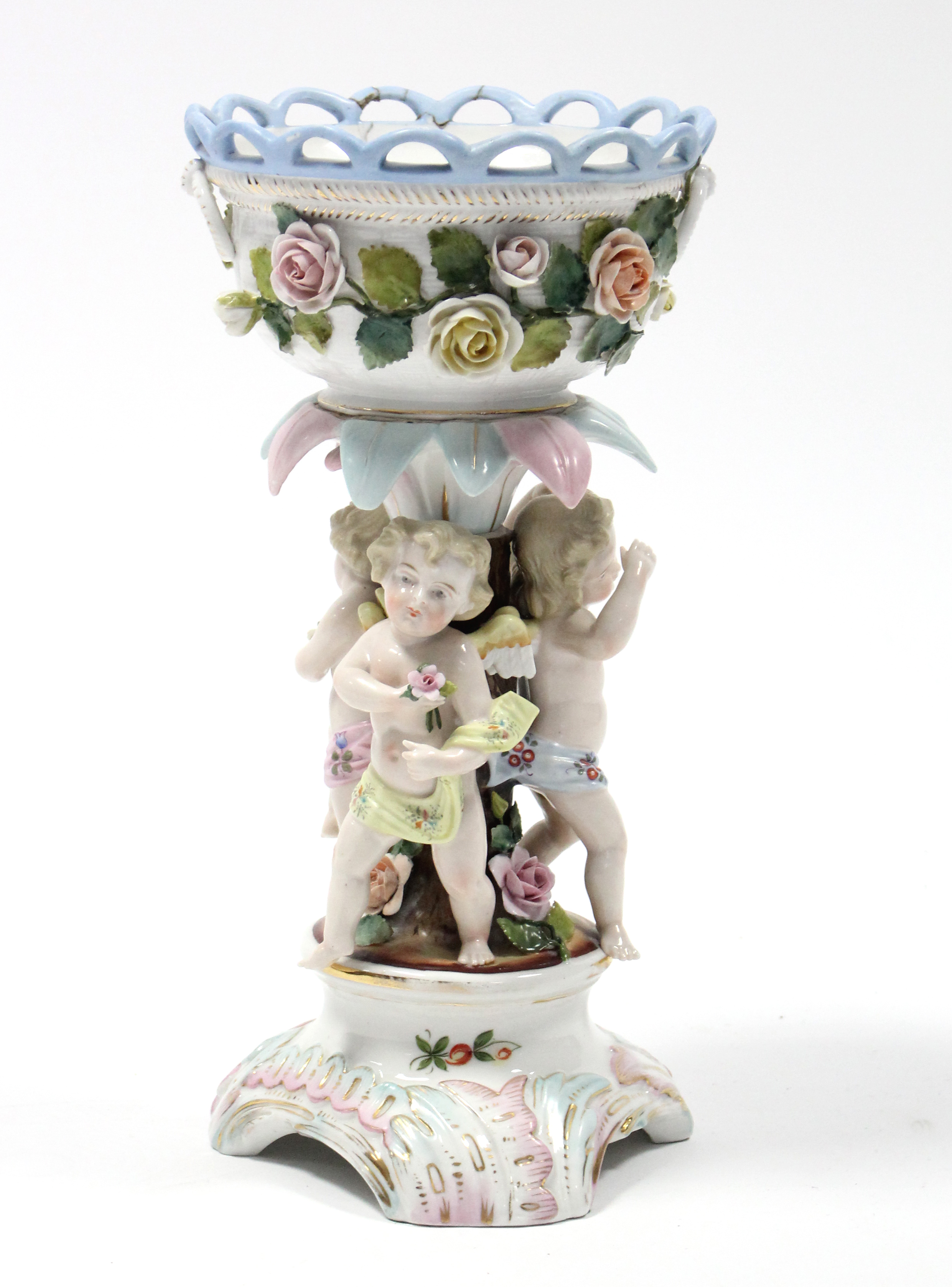 Lot 167 - A Sitzendorf porcelain centrepiece with round floral-encrusted bowl supported by three cherubs, on