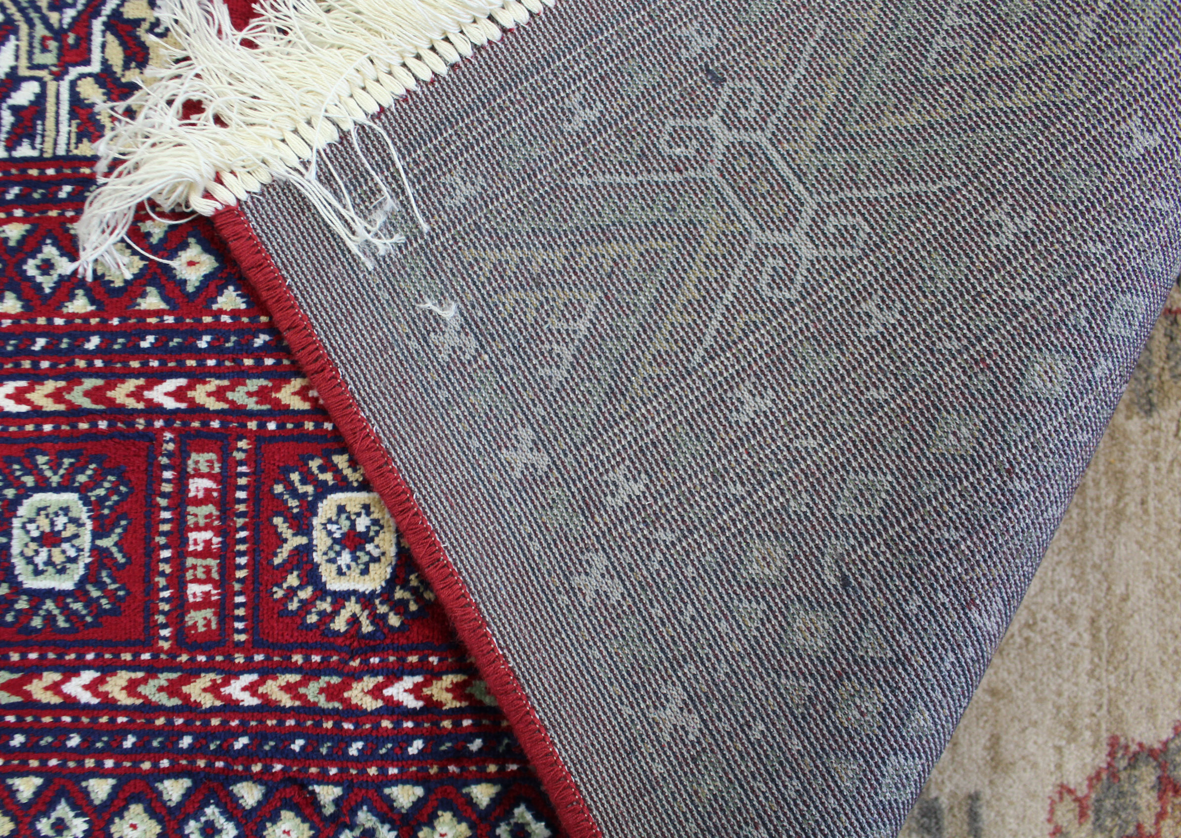 Lot 170 - A Bokhara carpet of crimson ground & with seven rows of nineteen guhls to centre within a multiple