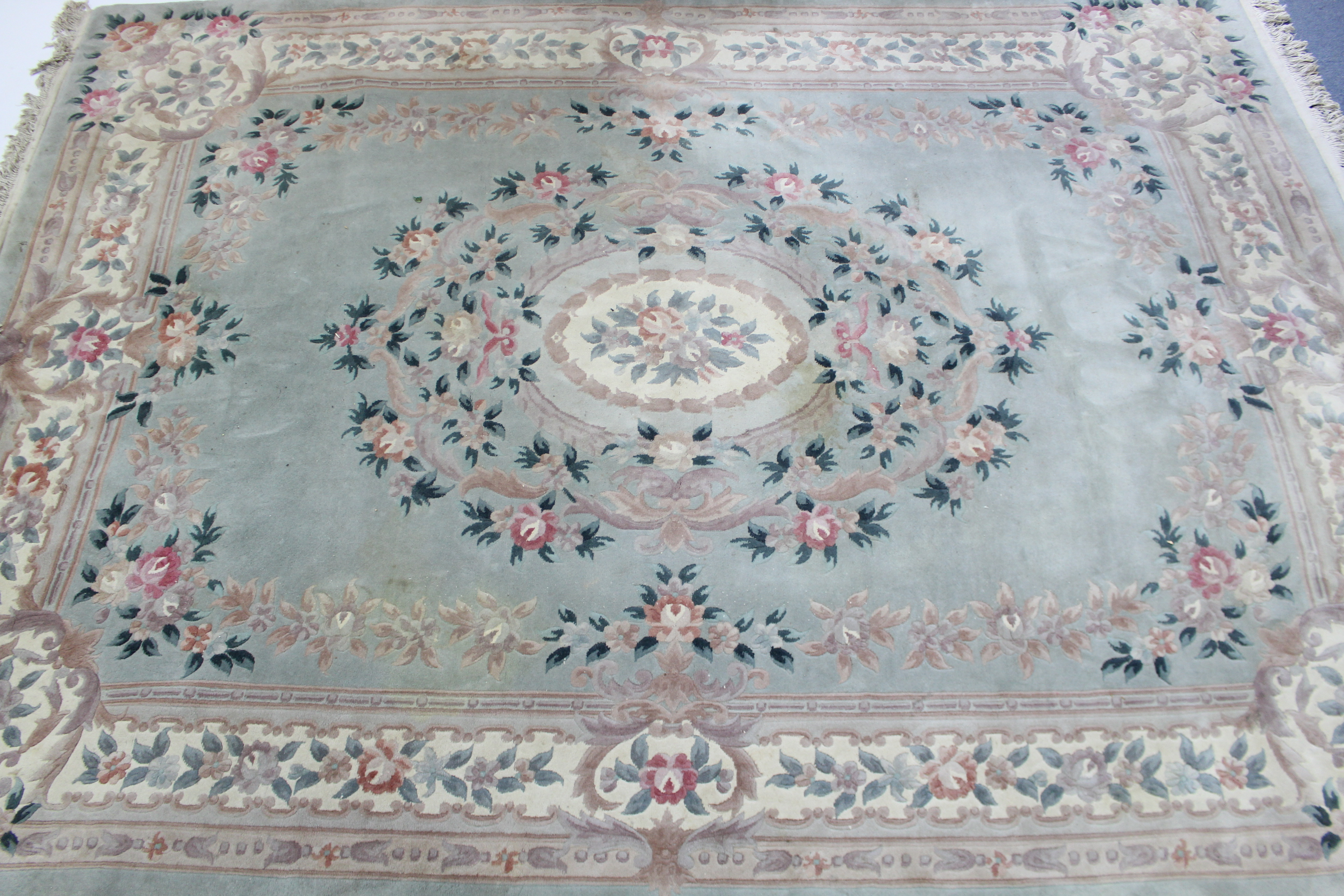 Lot 129 - A Chinese carpet of pale green & ivory ground, with all-over floral design to centre within a wide