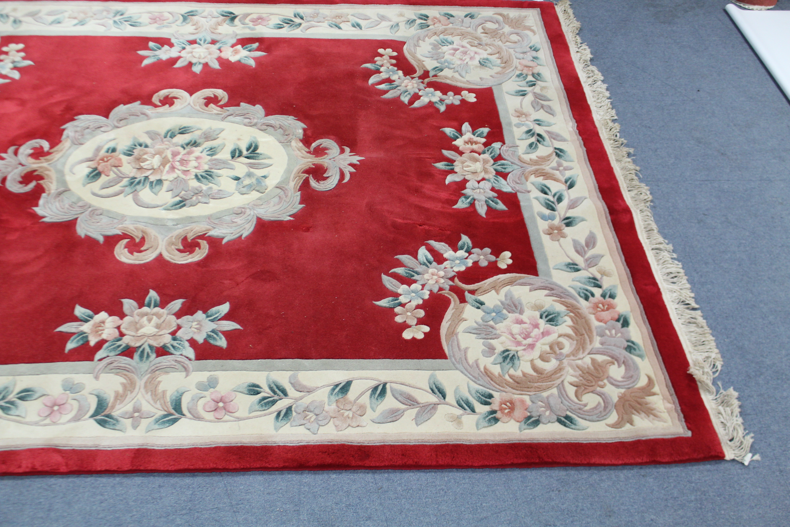 "Lot 152 - A Chinese carpet of crimson ground with central medallion & wide floral borders, 122"" x 95""."