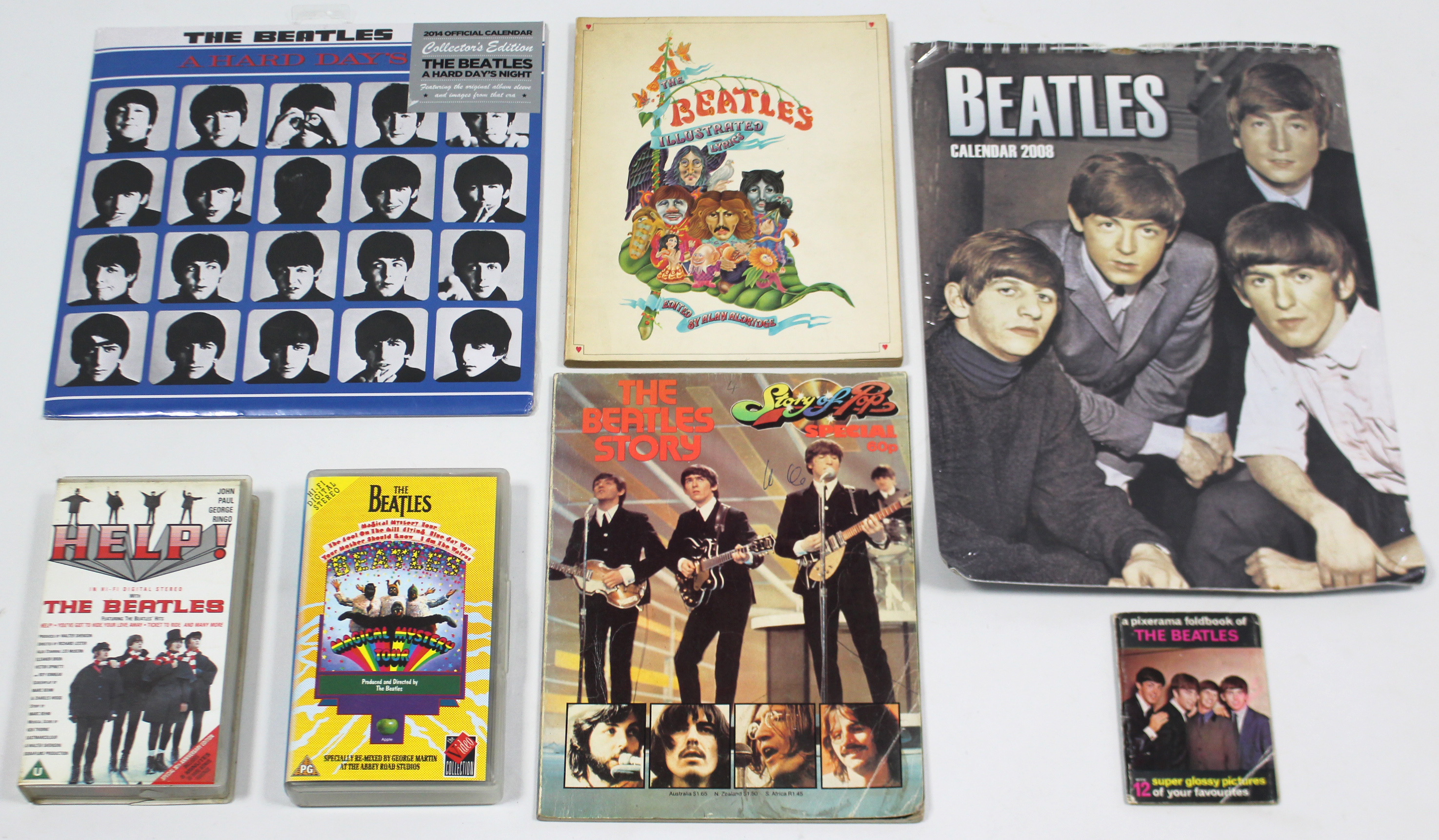 """Lot 39 - Two Beatles calendars; three volumes on """"The Beatles""""; & two Beatles video cassettes."""