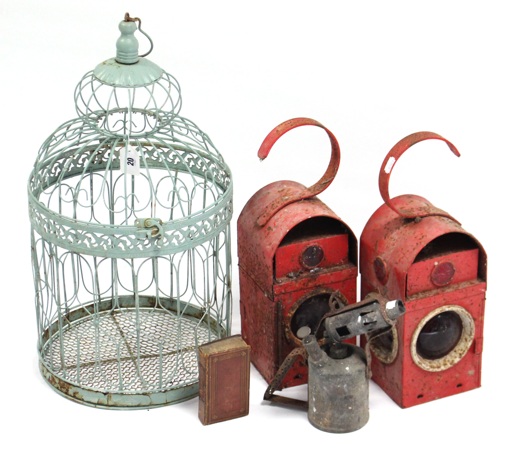 Lot 20 - A pale green painted wirework birdcage; two railway lanterns; a small leather-bound volume; a blow-