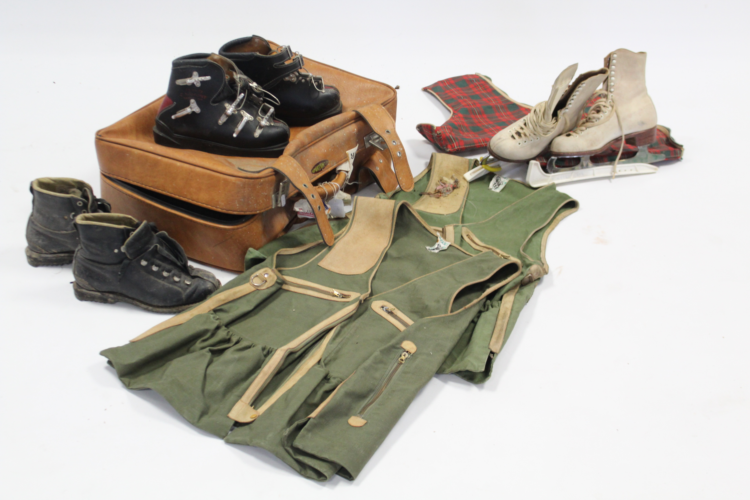 Lot 12 - A pair of Saga ladies ice skates; two pairs of leather ski boots; & two Ghillie's jackets.