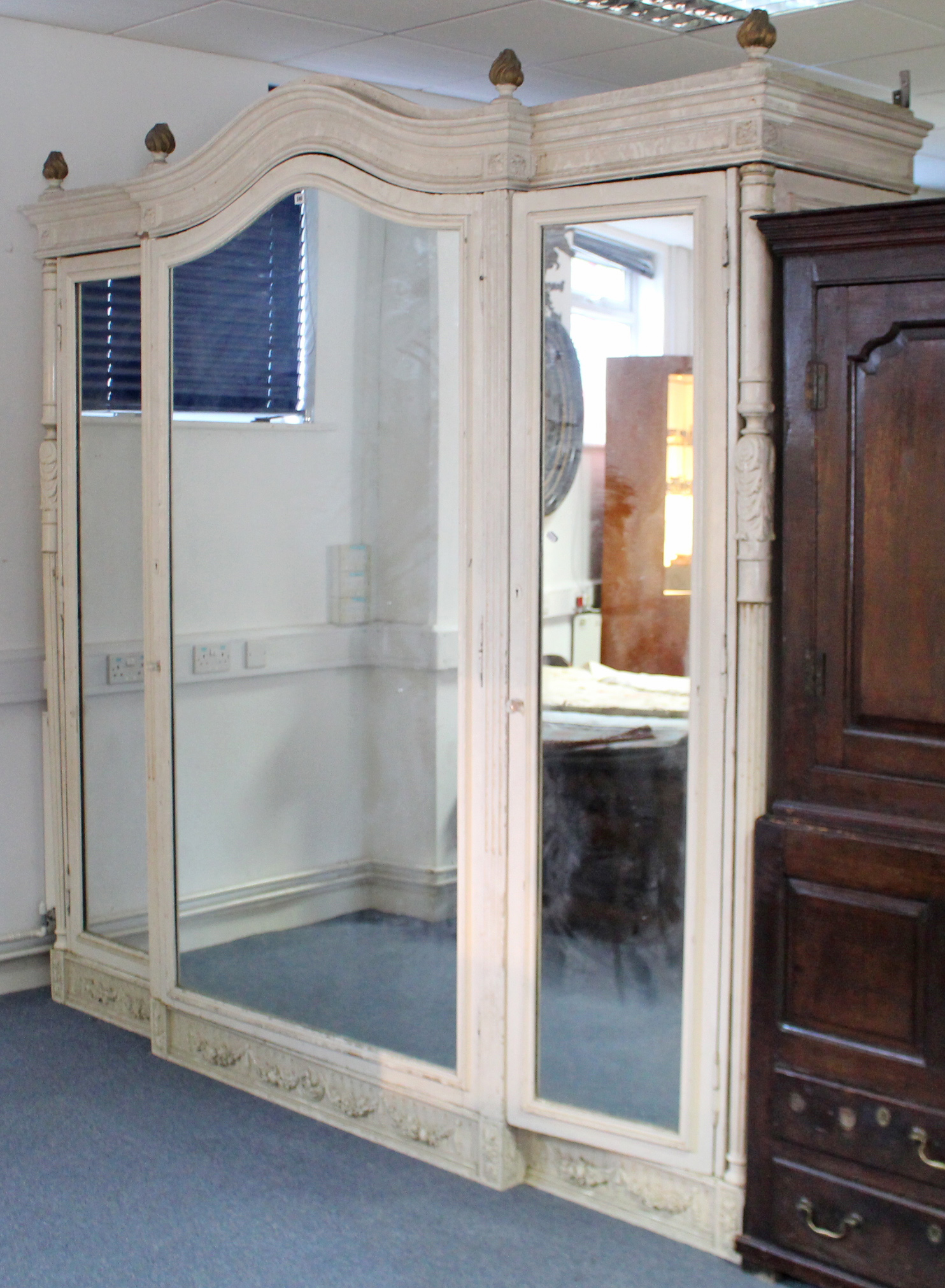 Lot 254 - A large painted mahogany wardrobe with shaped cornice, panel door to centre with mirror door