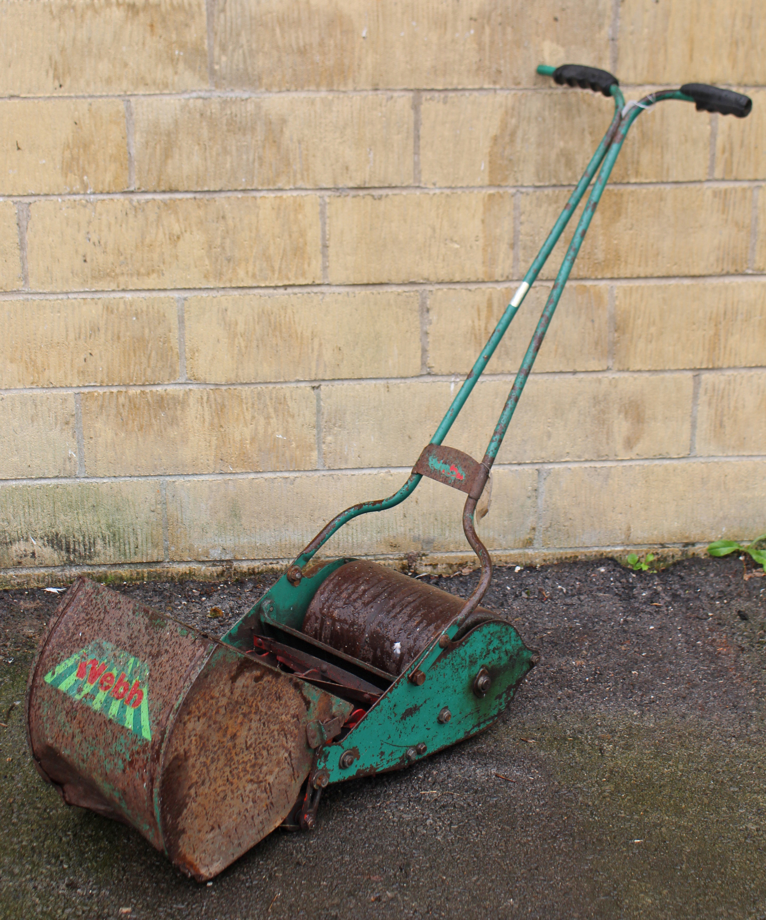 Lot 2 - A 'WEBB' child's toy push-along mower, with grass box, worn paintwork.