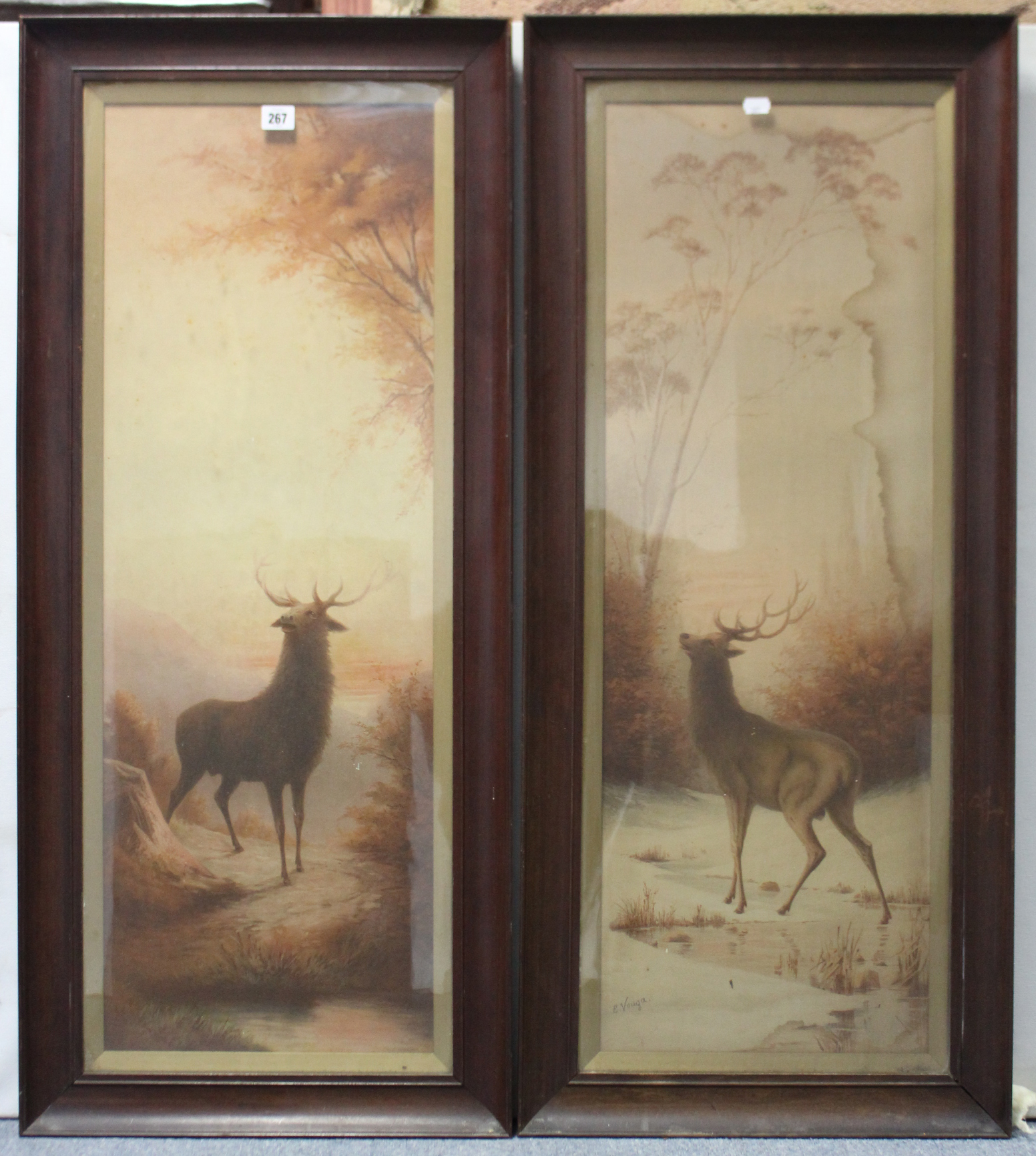 "Lot 267 - A pair of coloured prints of stags after E.Vouga, 35¾"" x 12¼"" in matching glazed mahogany frames."