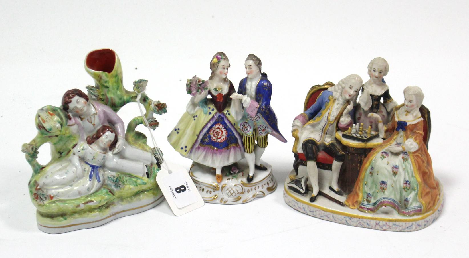 """Lot 63 - A Victorian Staffordshire pottery flat-back romantic figure group spill vase, 5¼"""" high; & two"""