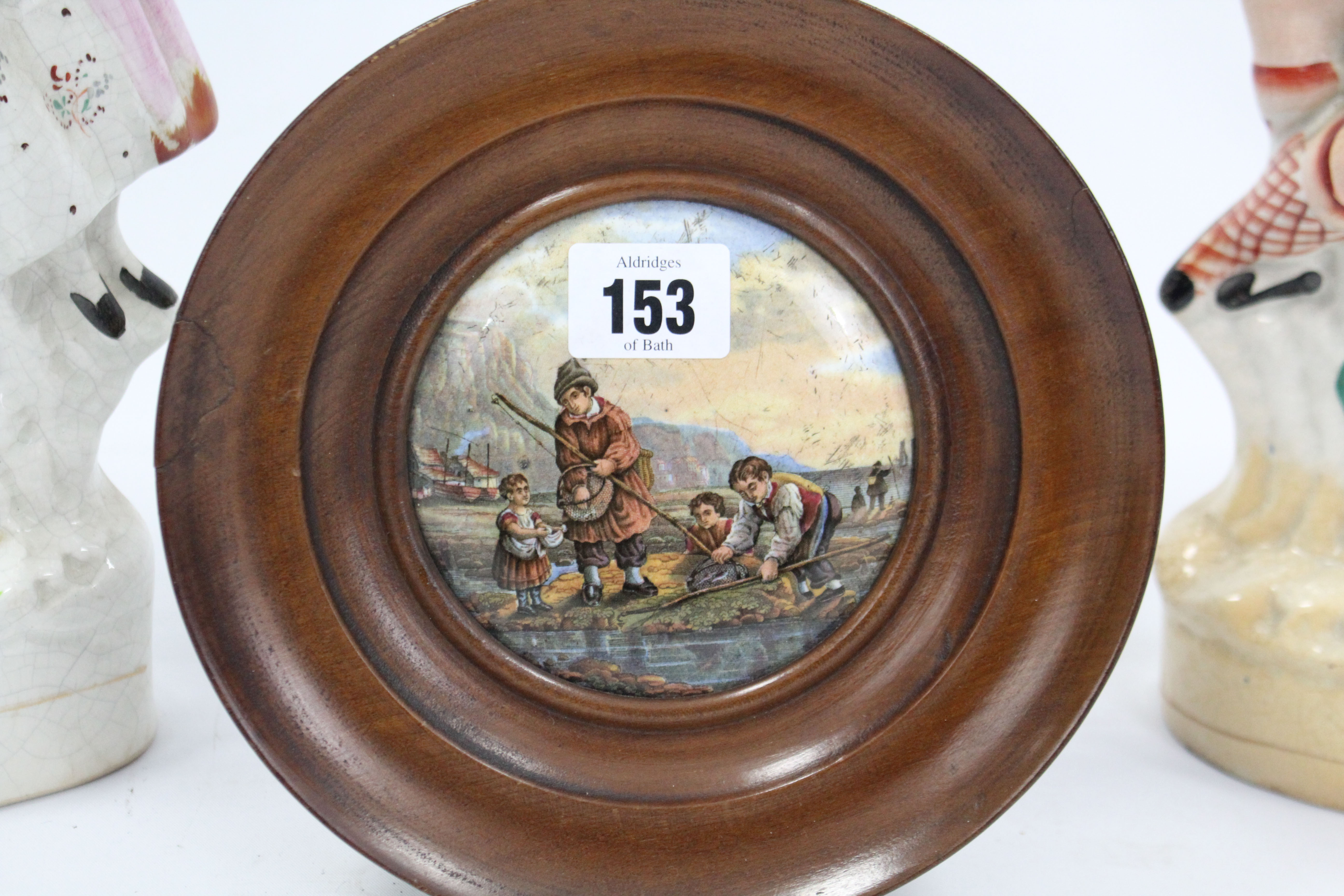 "Lot 153 - An Edwardian inlaid-mahogany frame wall mirror, 29 x 35¼""; two Prattware type pot lids, both framed;"