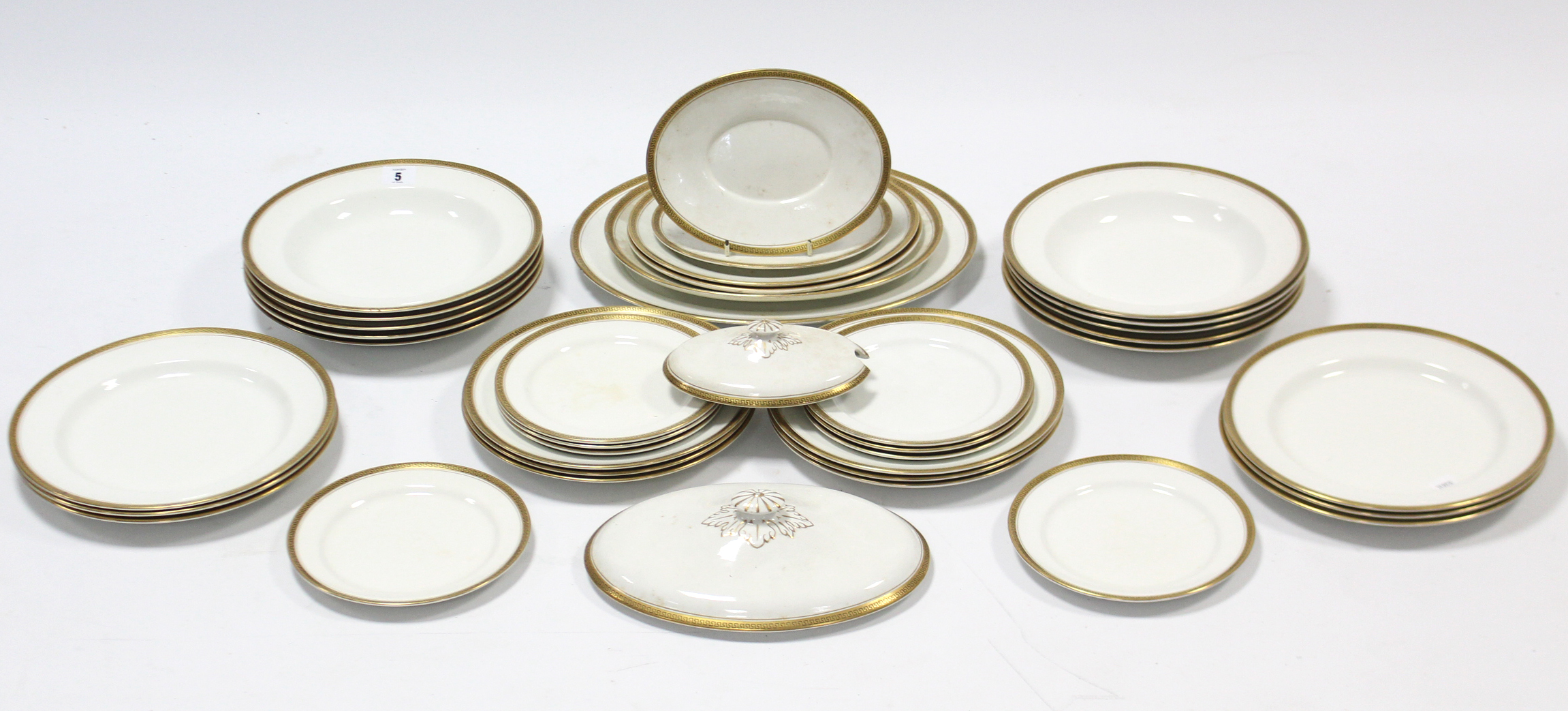 Lot 62 - A Bishop china thirty-four piece part dinner service of white ground & with gold rims, part w.a.f.