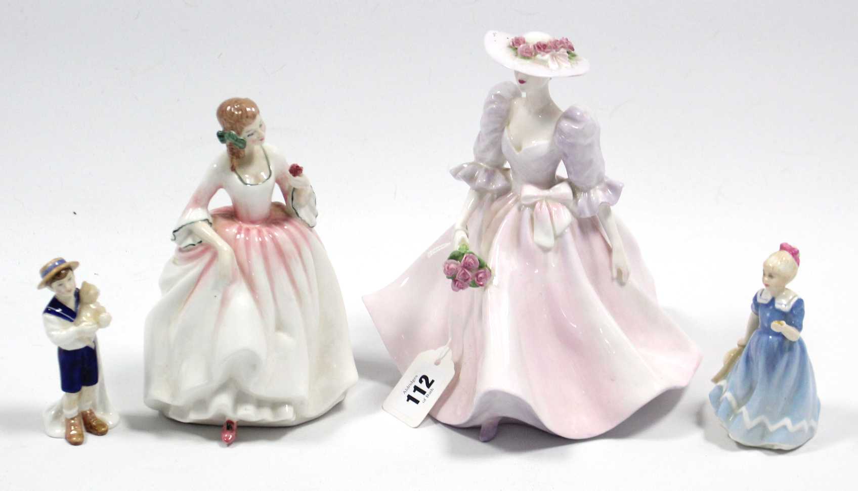 """Lot 164 - Three Royal Doulton figures """"A Posy for You"""" (HN 3606); """"Tender Moment"""" (HN 3303), & """"Special"""