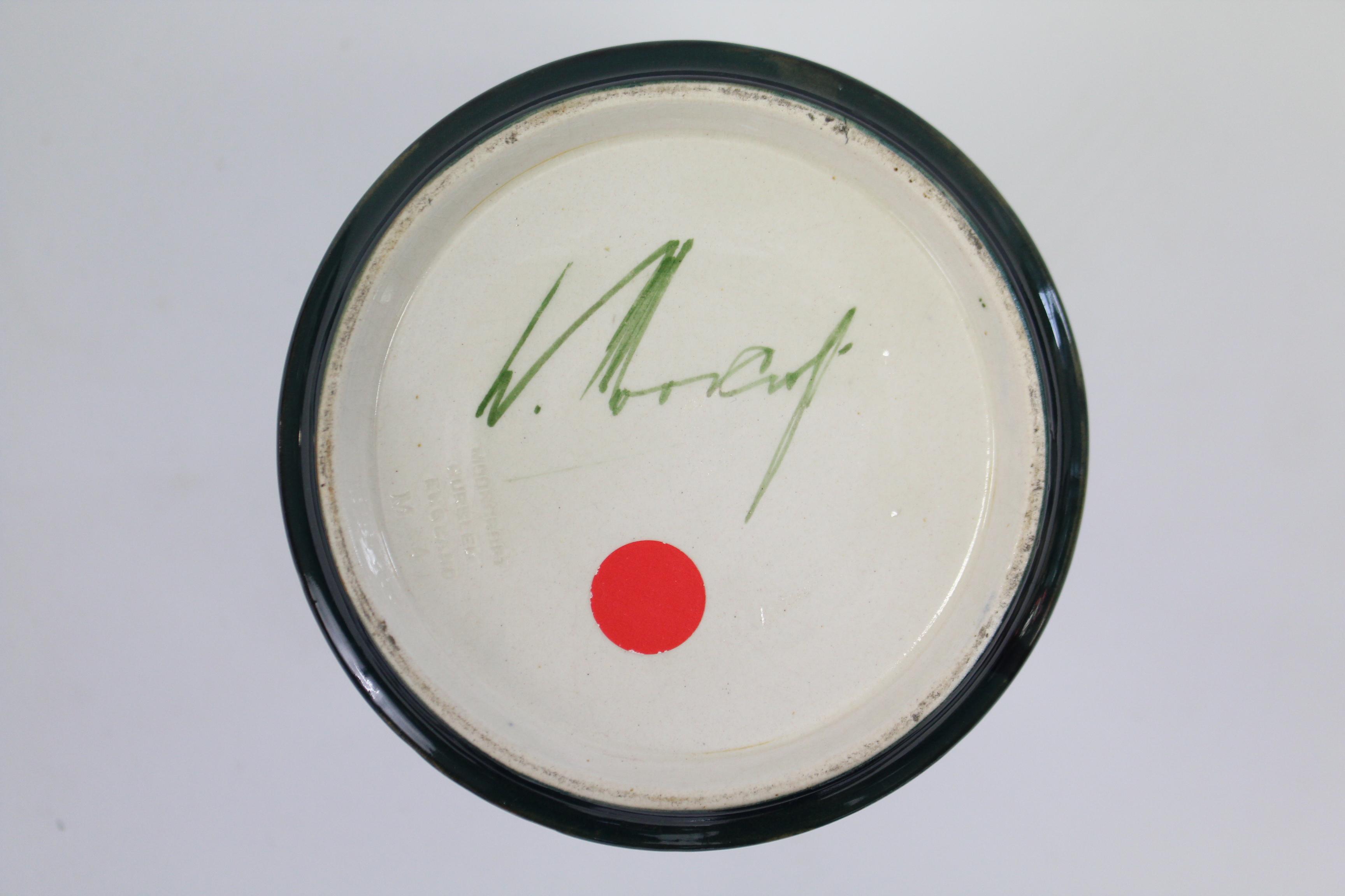 "Lot 247 - A Moorcroft ""Pomegranate"" pattern trumpet-shaped vase, signed W. Moorcroft to base, 8½"" high."