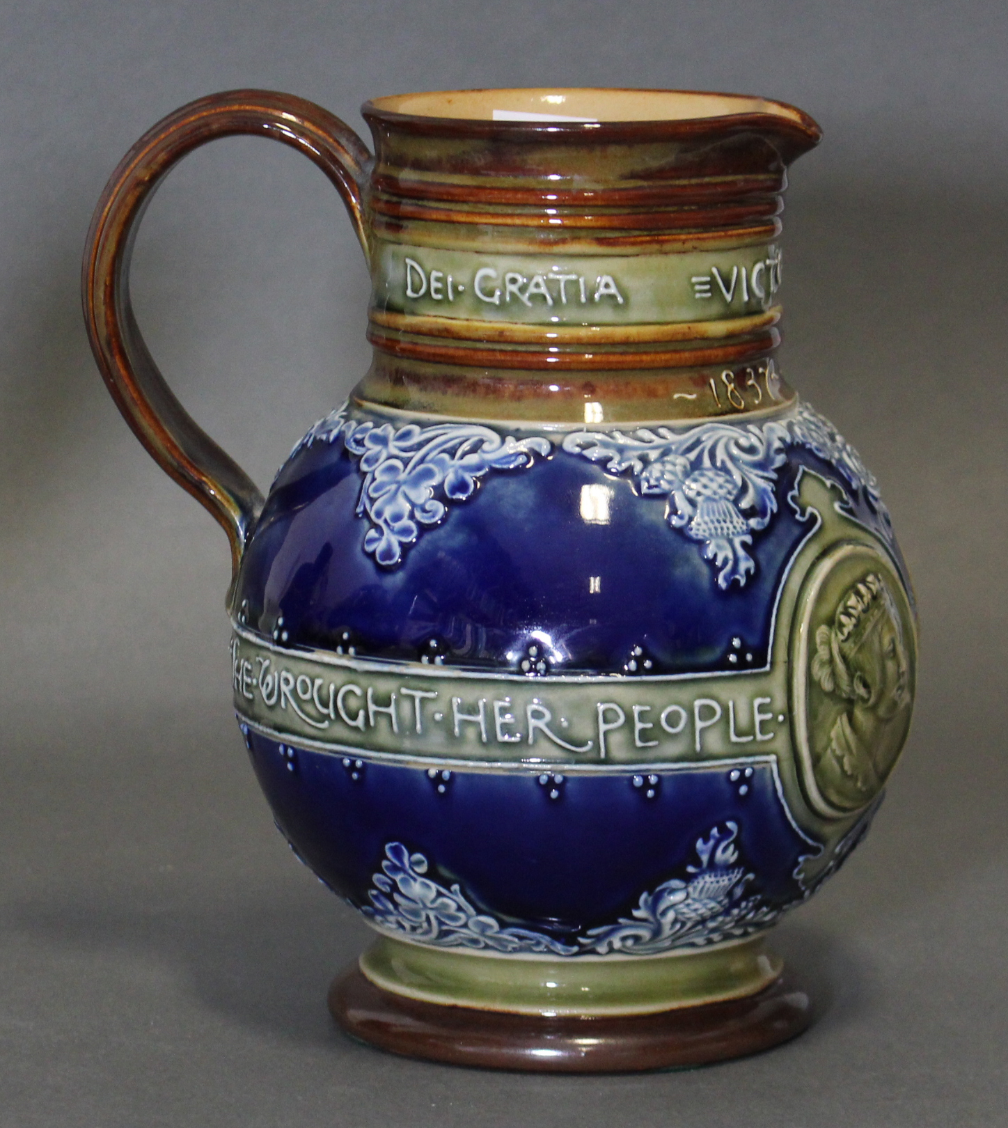 Lot 219 - A late 19th century Doulton Lambeth stoneware jug commemorating the Diamond Jubilee of Queen